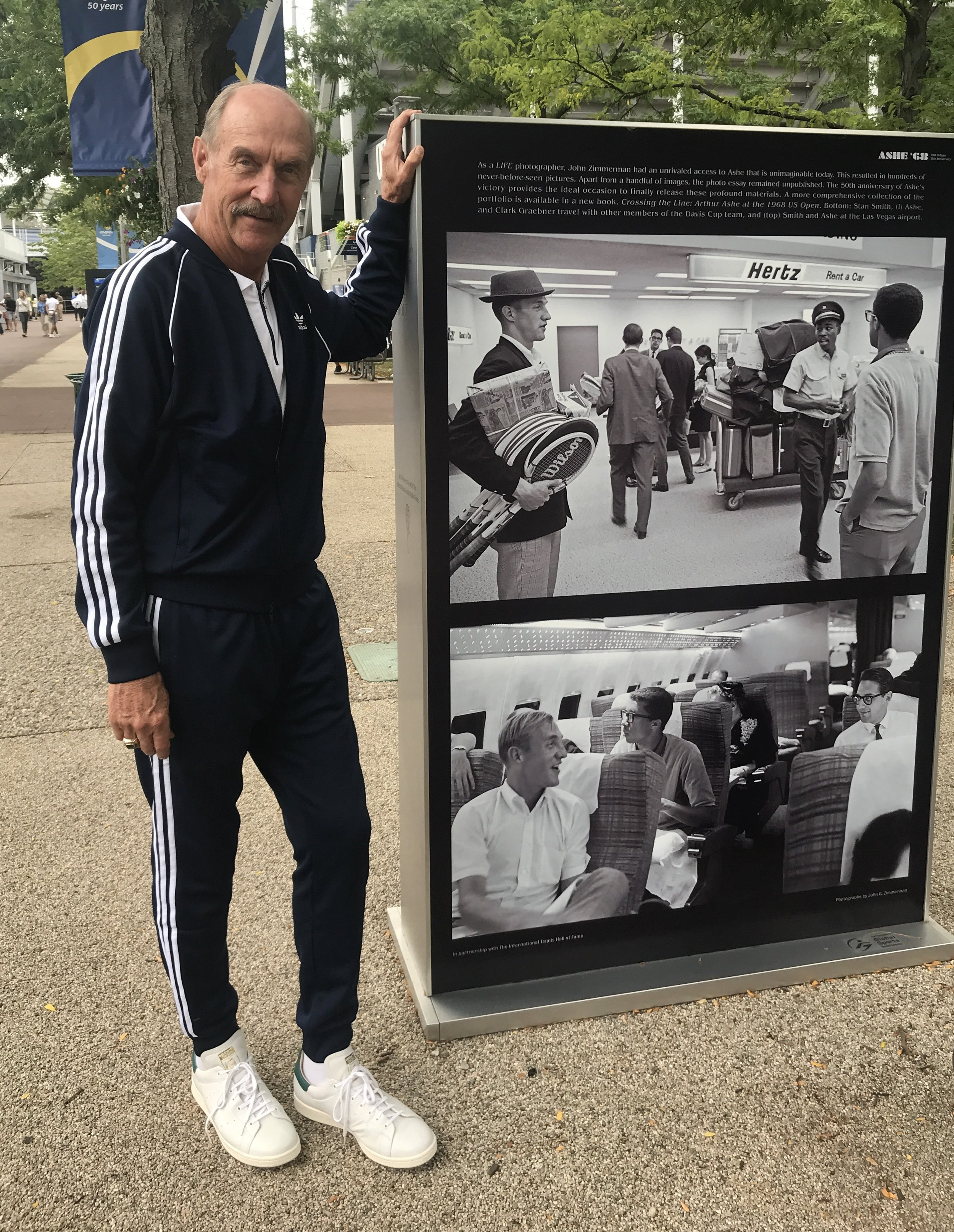 "Stan Smith, in 1968 with great friend Arthur Ashe, and now. Stan is a former world No. 1 American tennis player, US Open ('71) and Wimbledon ('72) singles champion who also, with his partner Bob Lutz, formed one of the most successful doubles teams of all time. But, as his beautiful new book (by Rizzoli) points out on the cover, ""Some people think I'm a shoe."""