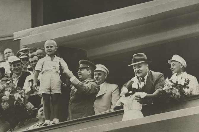 "Stalin and Molotov receiving flowers at ""Dynamo"" Stadium, 1940 (NYPL)"