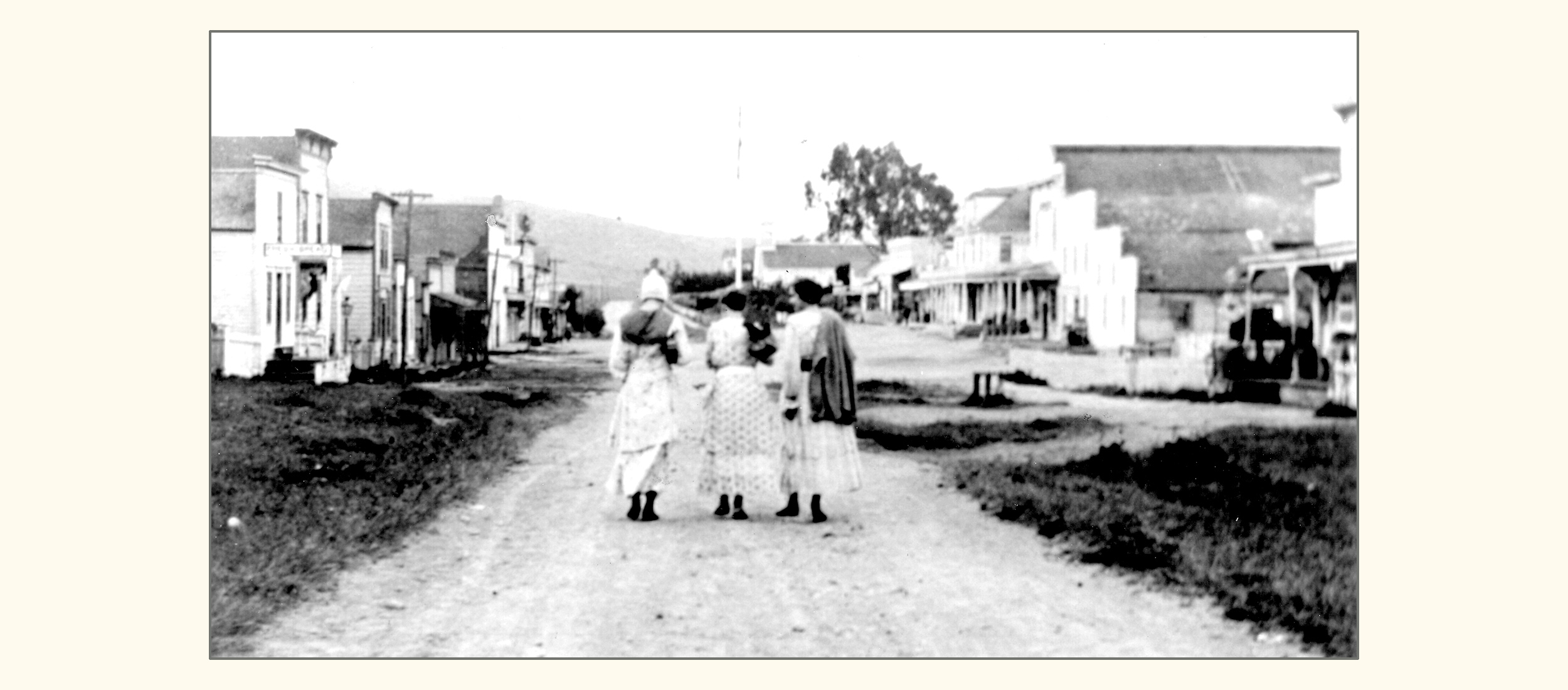 Three young women on Maine Street (Highway One), Tomales (1917)