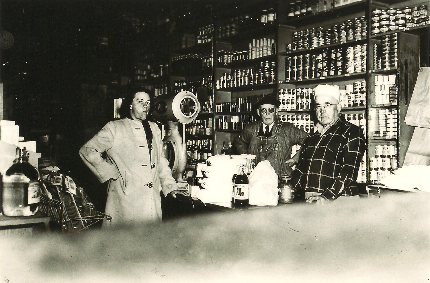 Brothers Charlie and Felix Salmina, with unidentified customer, in their Marshall general store — today the Hog Island Oyster building, circa 1930.