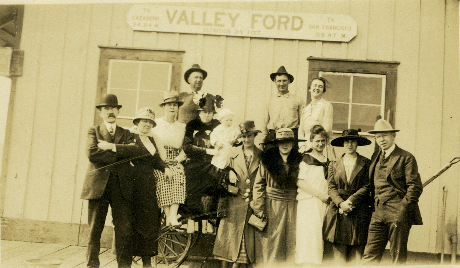 A well-dressed crowd poses at the Valley Ford railroad depot, circa early 20th century.