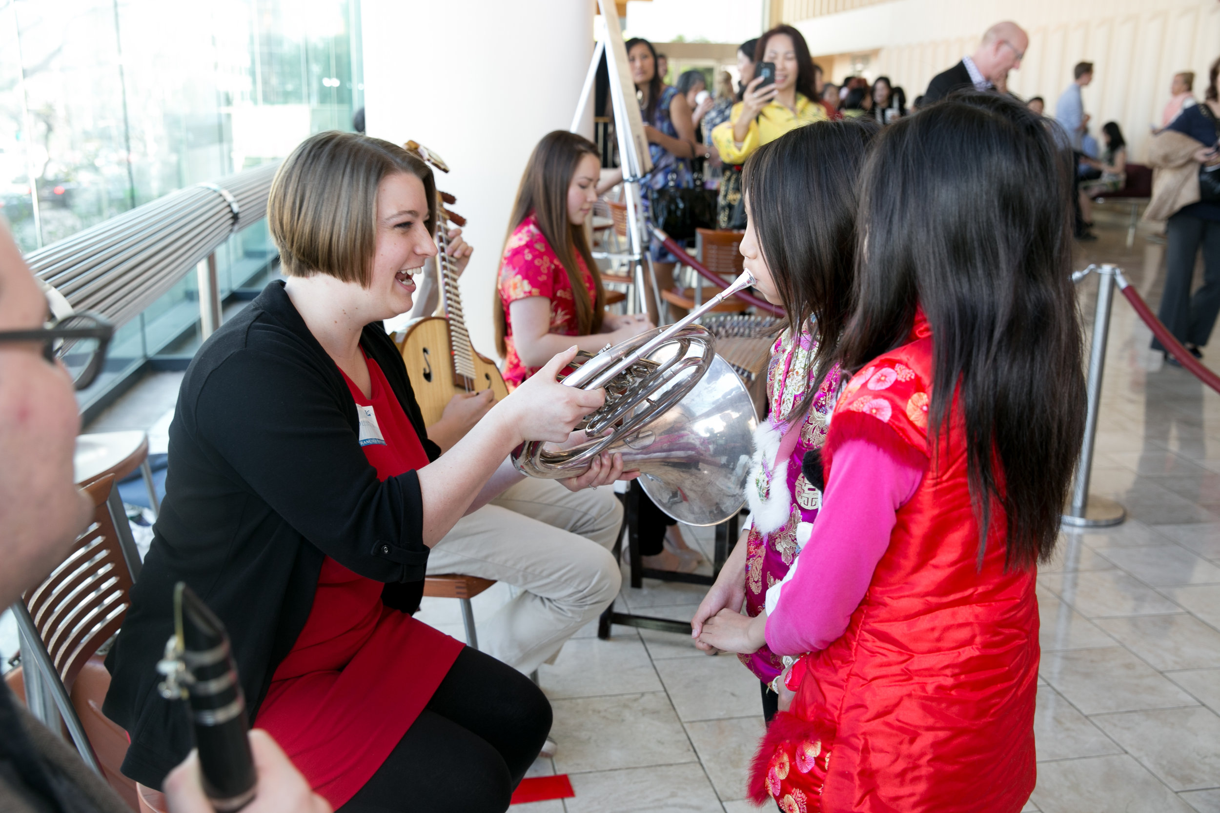 """Kids try out the """"instrument petting zoo,"""" a perennial lobby favorite."""