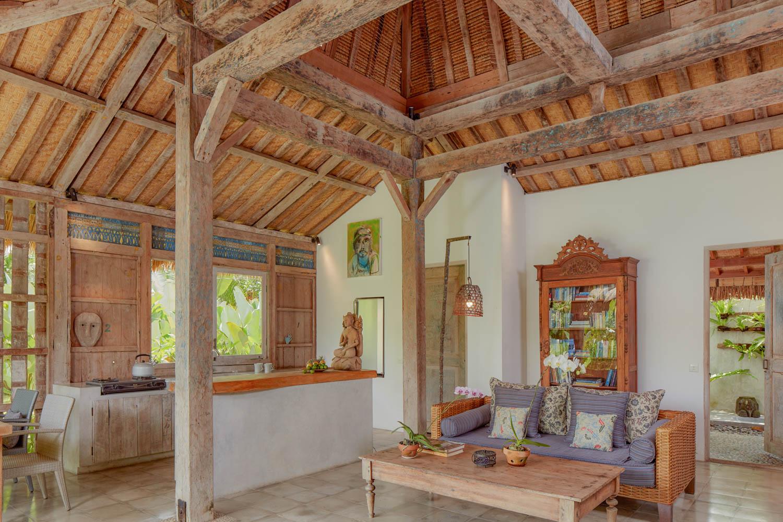 open living room with hand hewn teak beams