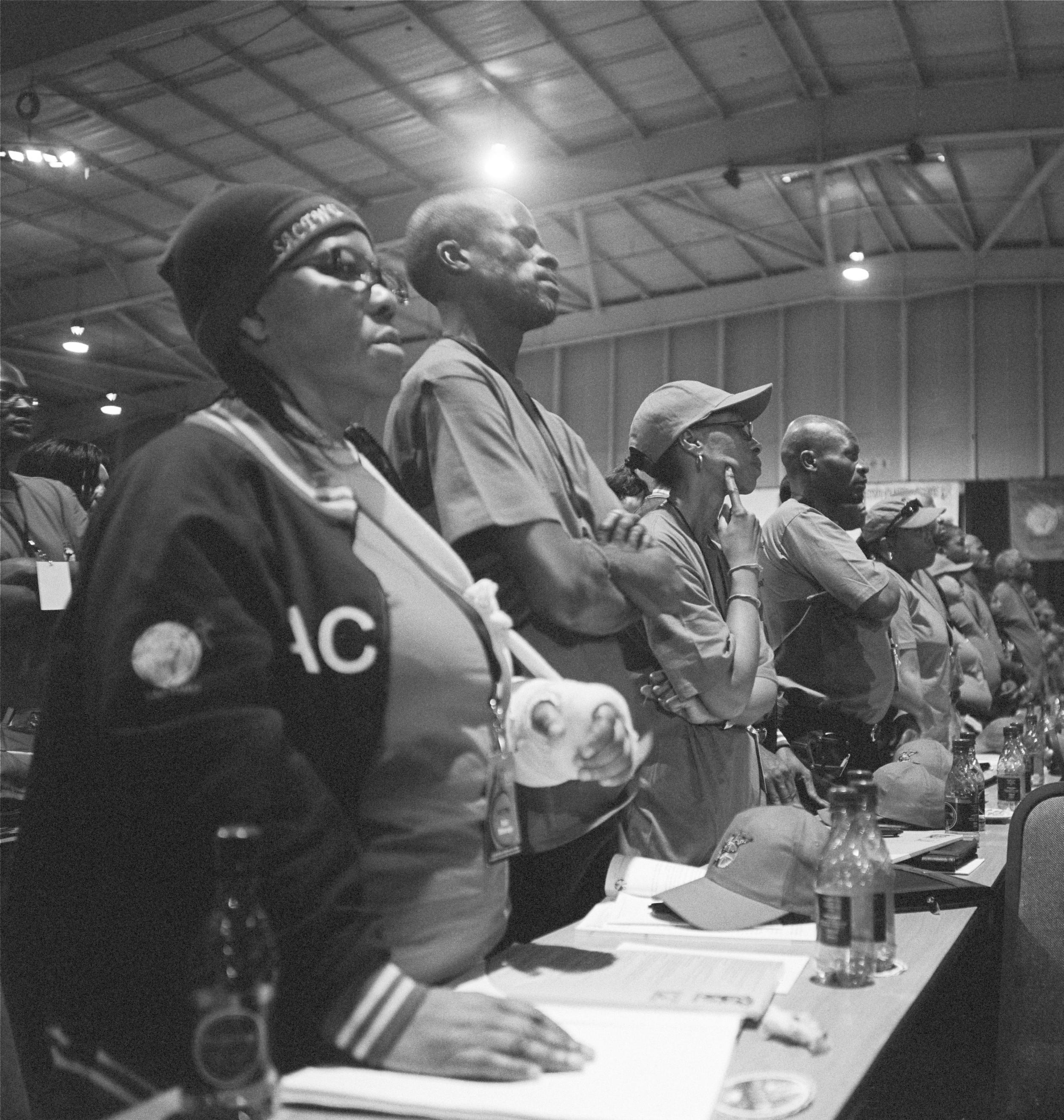 Busisiwe Msimango observing a minute silence, COSATU 10th National Congress, Johannesburg, September 2009