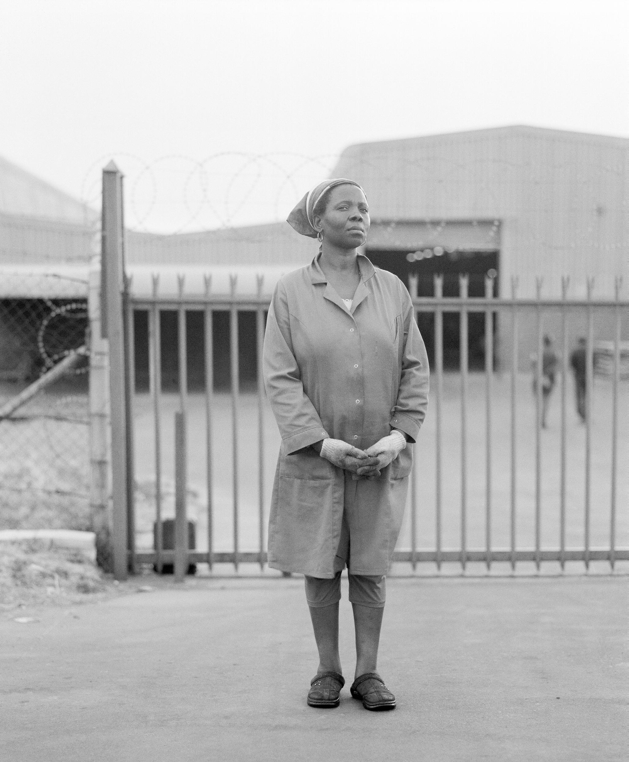 Tselane Adeline Lipali, outside Fu Chang textile company, Botshabelo, September 2009