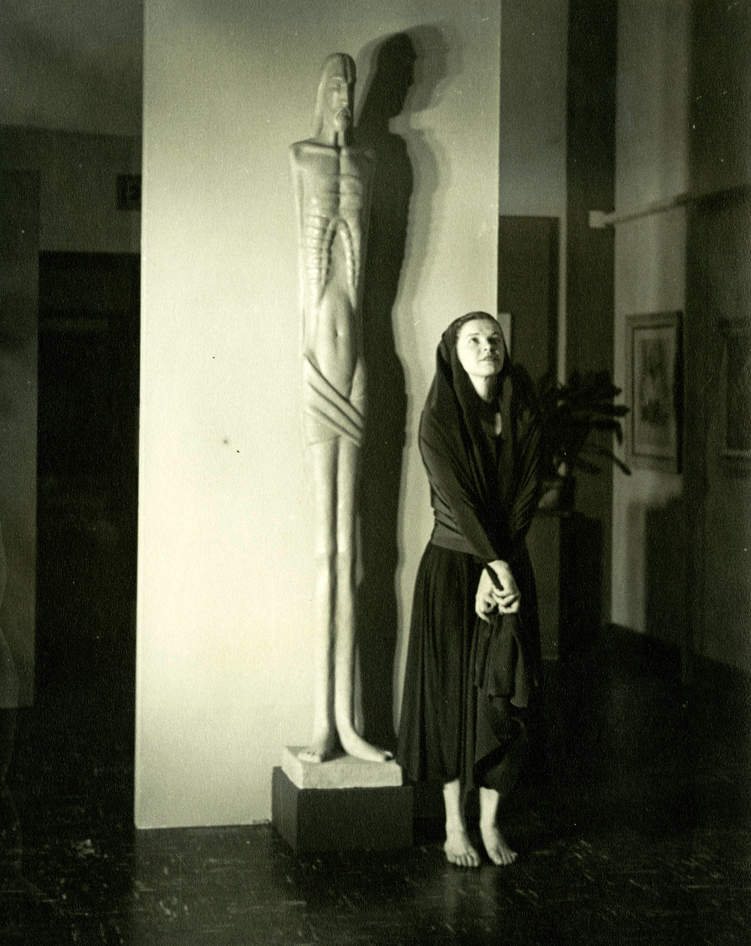 c1940s_nancy_gregson_next_to_a_statue.jpg