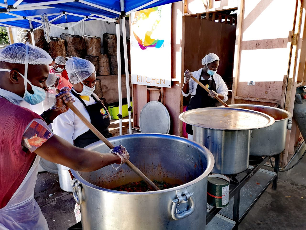 WCK's local team preparing meals for 2000 kids at the kitchen we built in Mezimbite.
