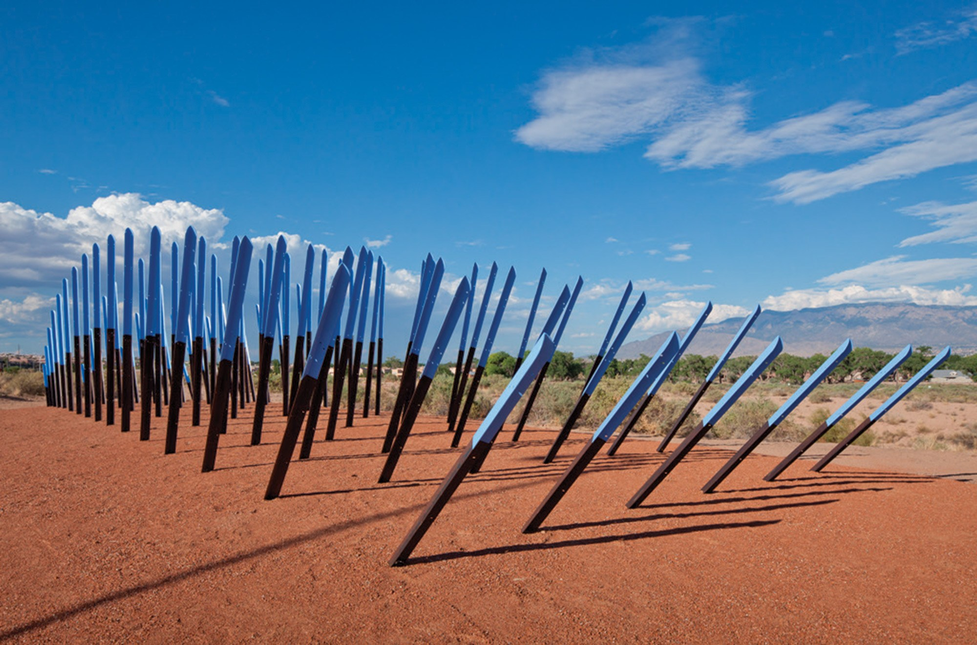 "ROBERT WILSON'S ""FLYWAY"" IS SITUATED AT THE ENTRANCE OF THE OPEN SPACE VISITOR CENTER IN ALBUQUERQUE, NEW MEXICO. IT'S MADE OF REPURPOSED STEEL BEAMS AND WAS INSPIRED BY VISUAL FORMS OF SANDHILL CRANES."