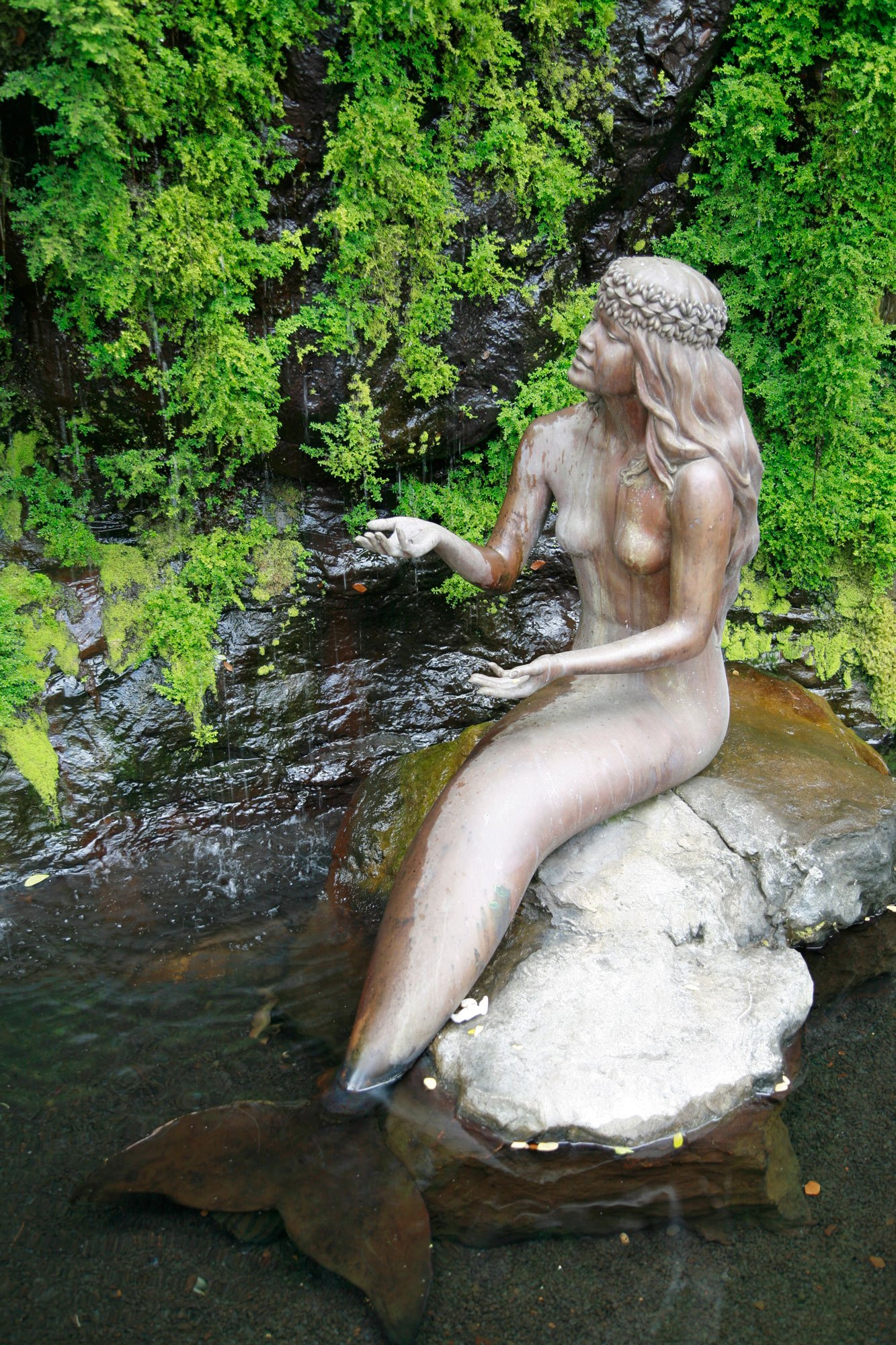 "THE ""SEATED MERMAID"" ON THE ROCK IS BY ARTIST HERB KANE"