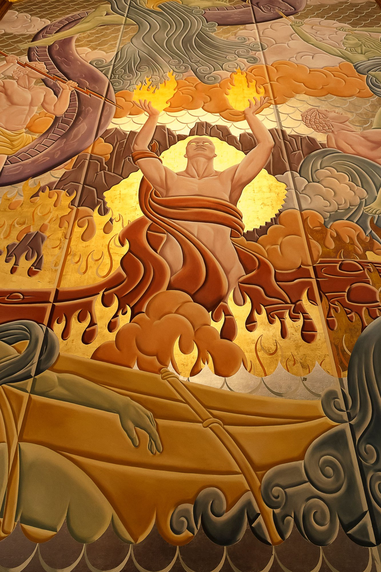 THE GOLDEN WALL MURAL IS MADAME PELE BY EVANS AND BROWN. IT DEPICTS THE BATTLE BETWEEN FIRE AND WATER