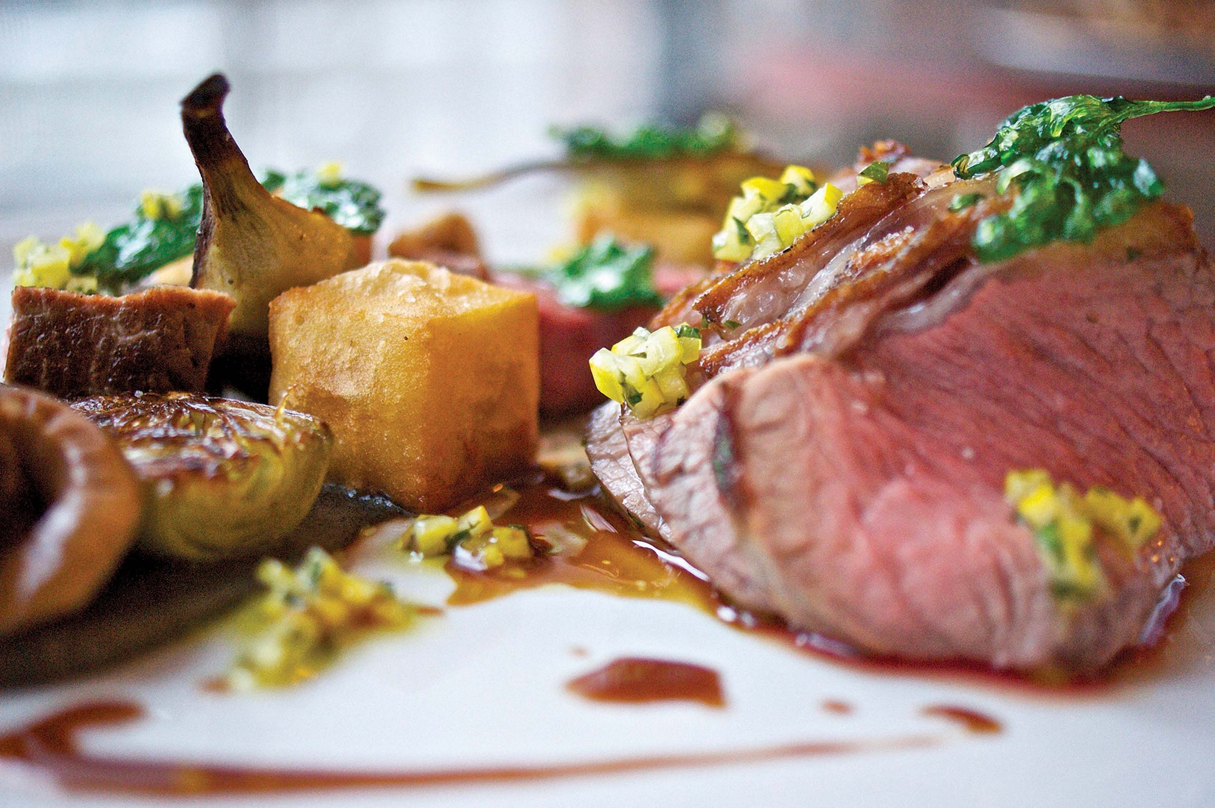 Slow Roasted Lamb with Winter Vegetables and Polenta - Sunset Marquis Hotel