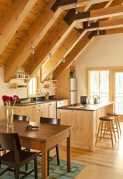 A recent CJAB project featured five Maine wood species in the kitchen alone. Photo: Trent Bell