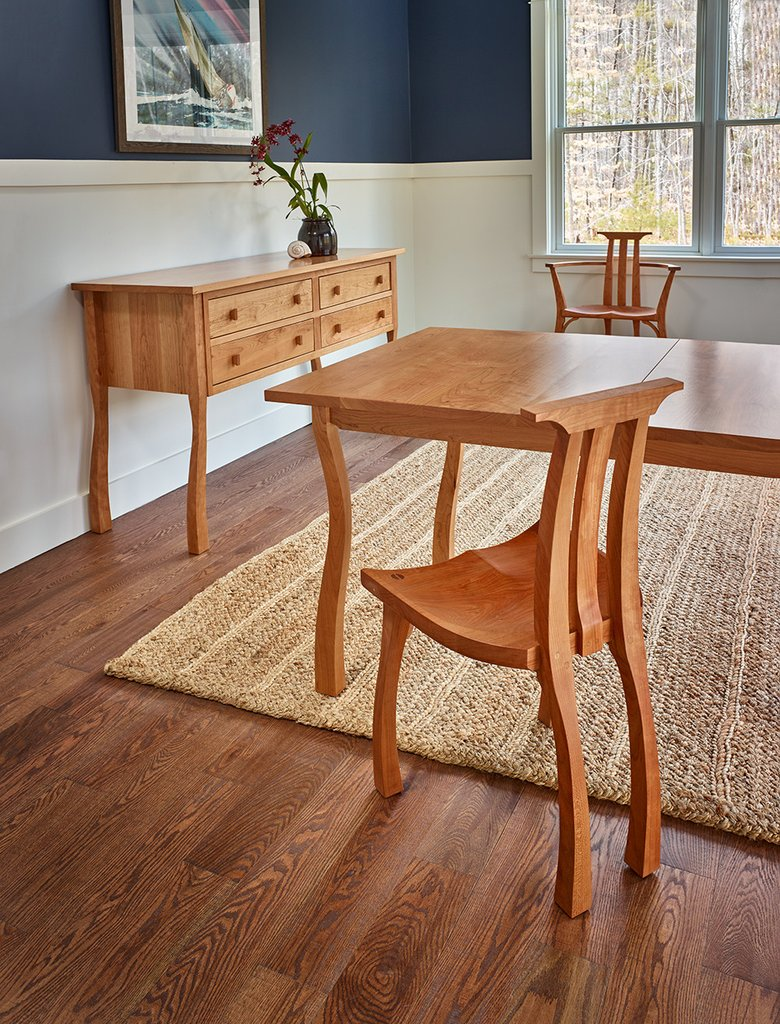 Designed by Peter Thompson, this line of dining furniture features cherry, some of which is grown in Maine.