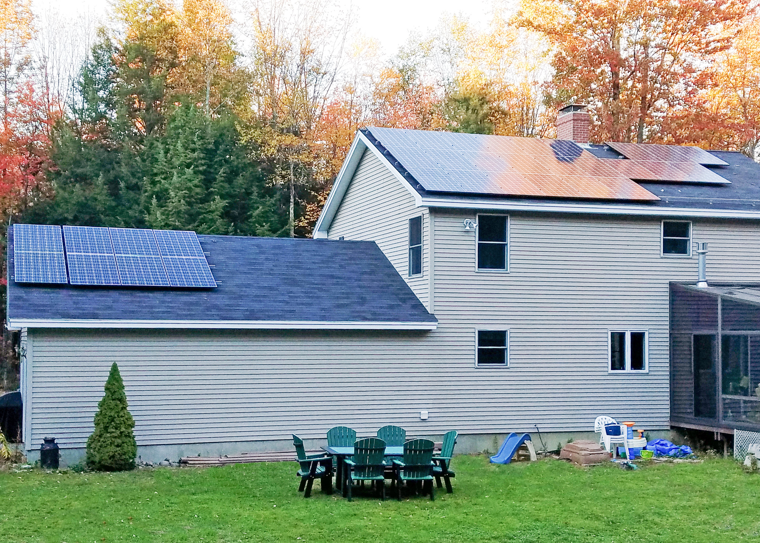 Matt & Carrie Thomas' home in Bowdoin has two solar arrays with the ability to put out about 10 kilowatts of electricity. He drives a Chevy Volt and uses wood and electric heat pumps to heat the home. Photo: ReVision Energy