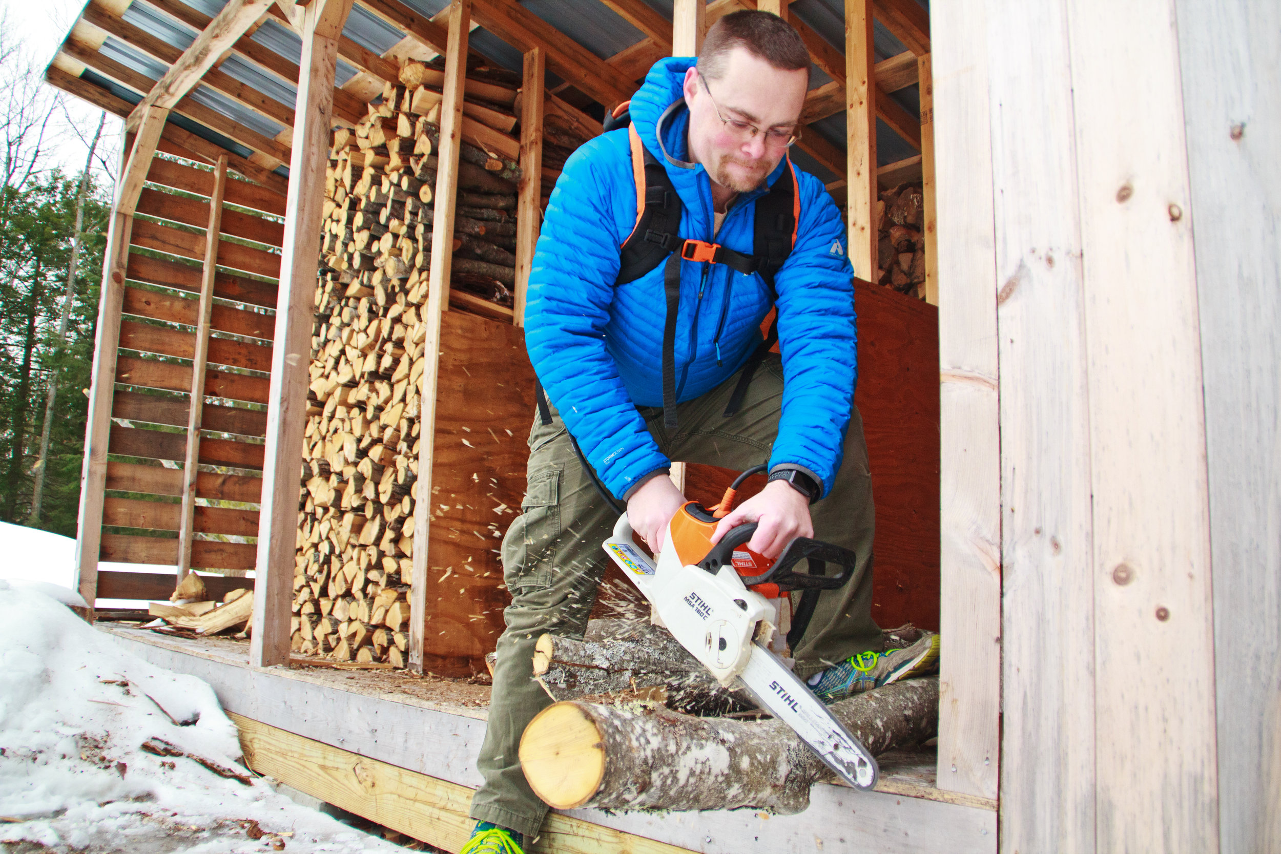 Matt Thomas has eliminated all fossil fuel-fired heating in his home, relying on an array of electric Stihl yard equipment to cut wood for heat.