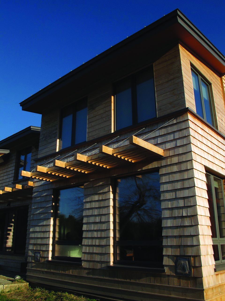 Abundant glass + solar shading = a home that's tuned for the environment and primed for saving on energy. Photo: BrightBuilt Home