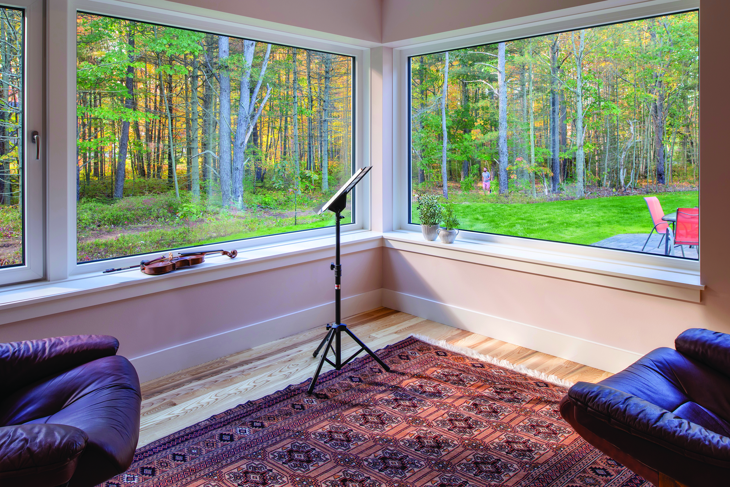 An inset sun room gazes out to the adjacent trail and invites wildlife watching while providing a cozy place to enjoy morning coffee.