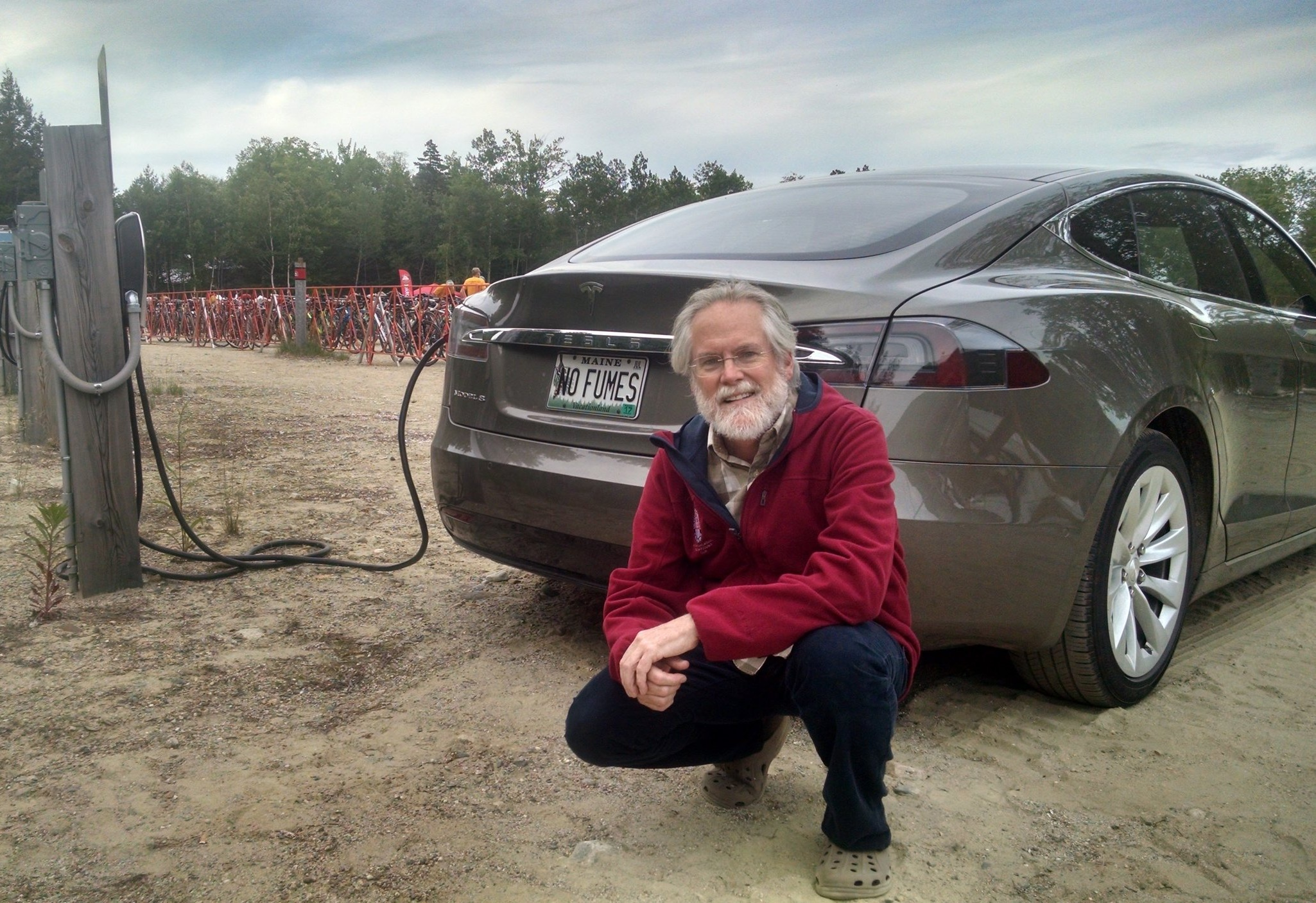 Scott Cowger charges his Tesla Model S at Sunday River in Newry where he was attending the Trek Across Maine. Sunday River offers three Tesla Level 2 chargers and one wall outlet available for public use.