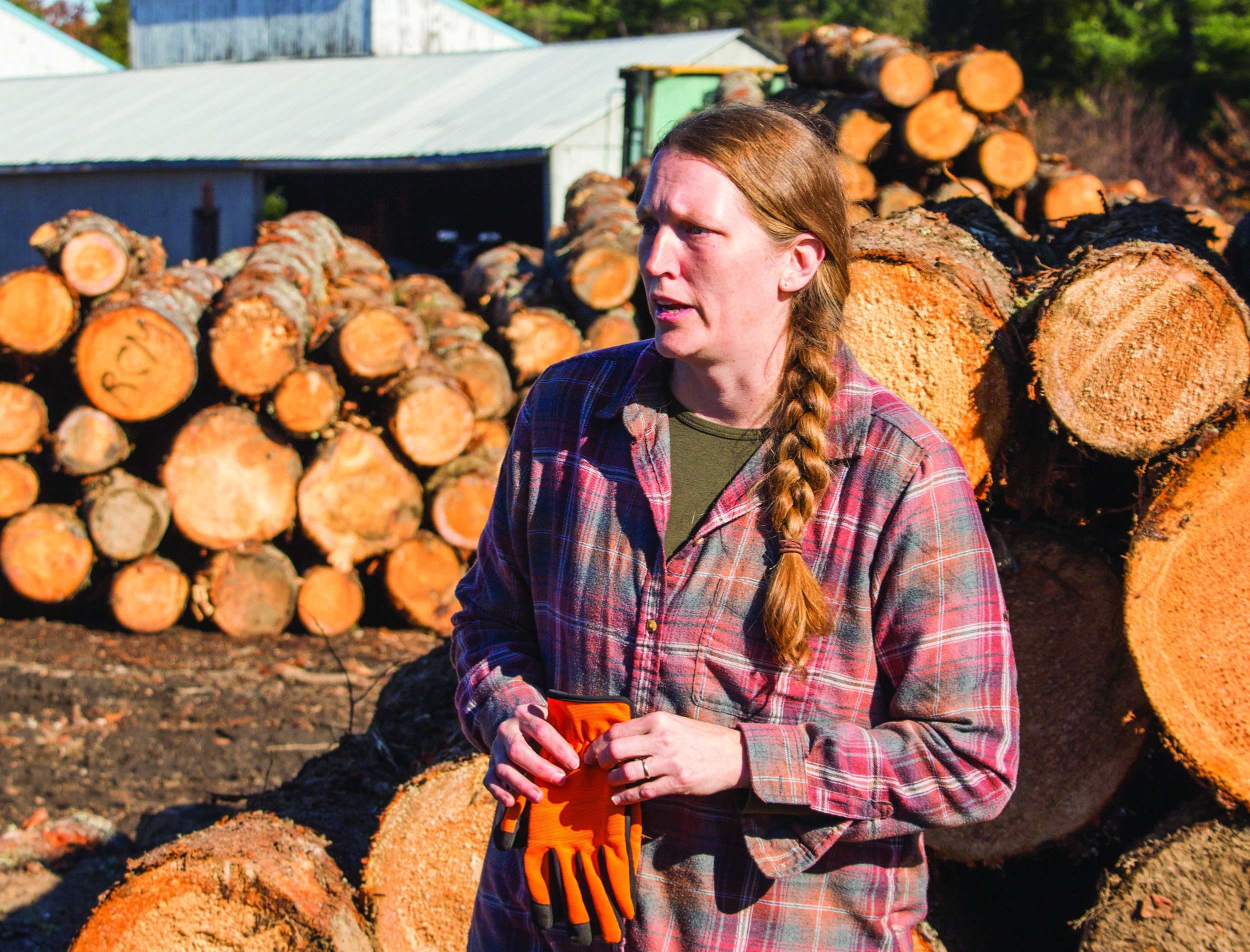 Wendy Patterson of Maschino Lumber, speaks to participants in a recent tour. Maschino Lumber is a fourth-generation, family-owned mill that sells hemlock, white pine and spruce for dimensional lumber, boards and siding in New Gloucester.  Photo: Phoebe Parker