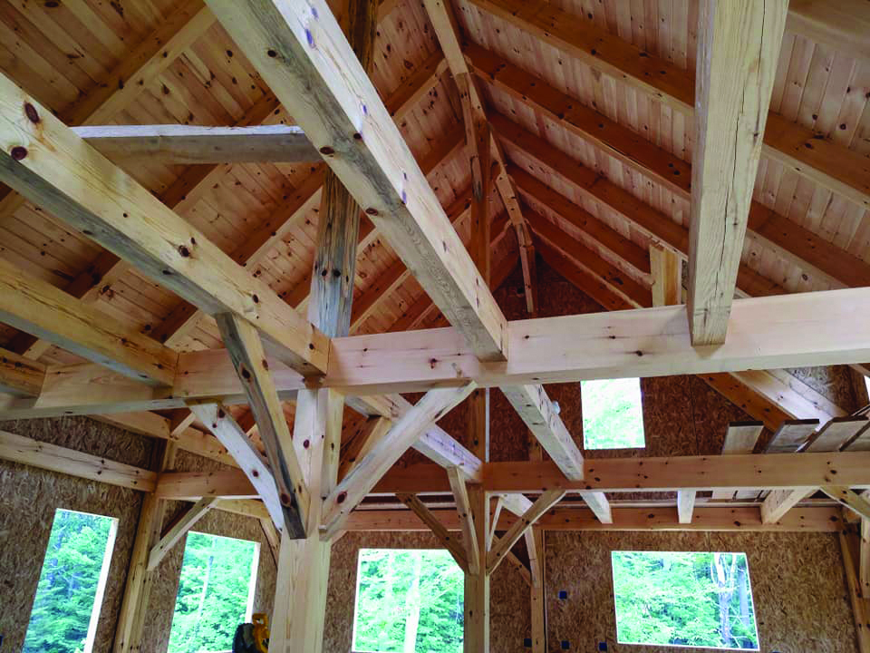 A timber frame home in Woolwich built by Maine Heritage Timber Frames. Most of the wood was sourced from the property and milled onsite. The remaining pieces were milled by Bickford Lumber.  Photo courtesy of Maine Heritage Timber Frames