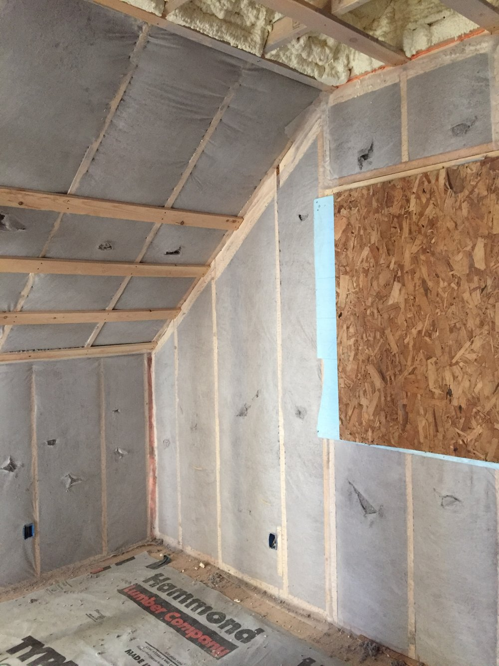 Wood fiber-based insulation, including dense-packed cellulose, is effective and has a low carbon footprint. Today's high-quality cellulose does not settle if installed properly and is pest-resistant, thanks to its mineral borate additive. Photo courtesy of Rook Energy Solutions.