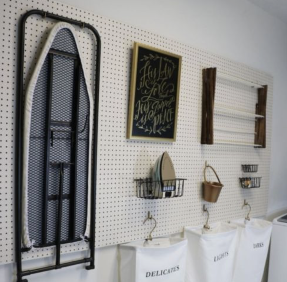 1. Put the wall to work - Hooks, shelving, even pegboard is a great way to get your stuff off the floor and out of the way! We recommend taking advantage of the space above your washer 7 dryer for some vertical storage.