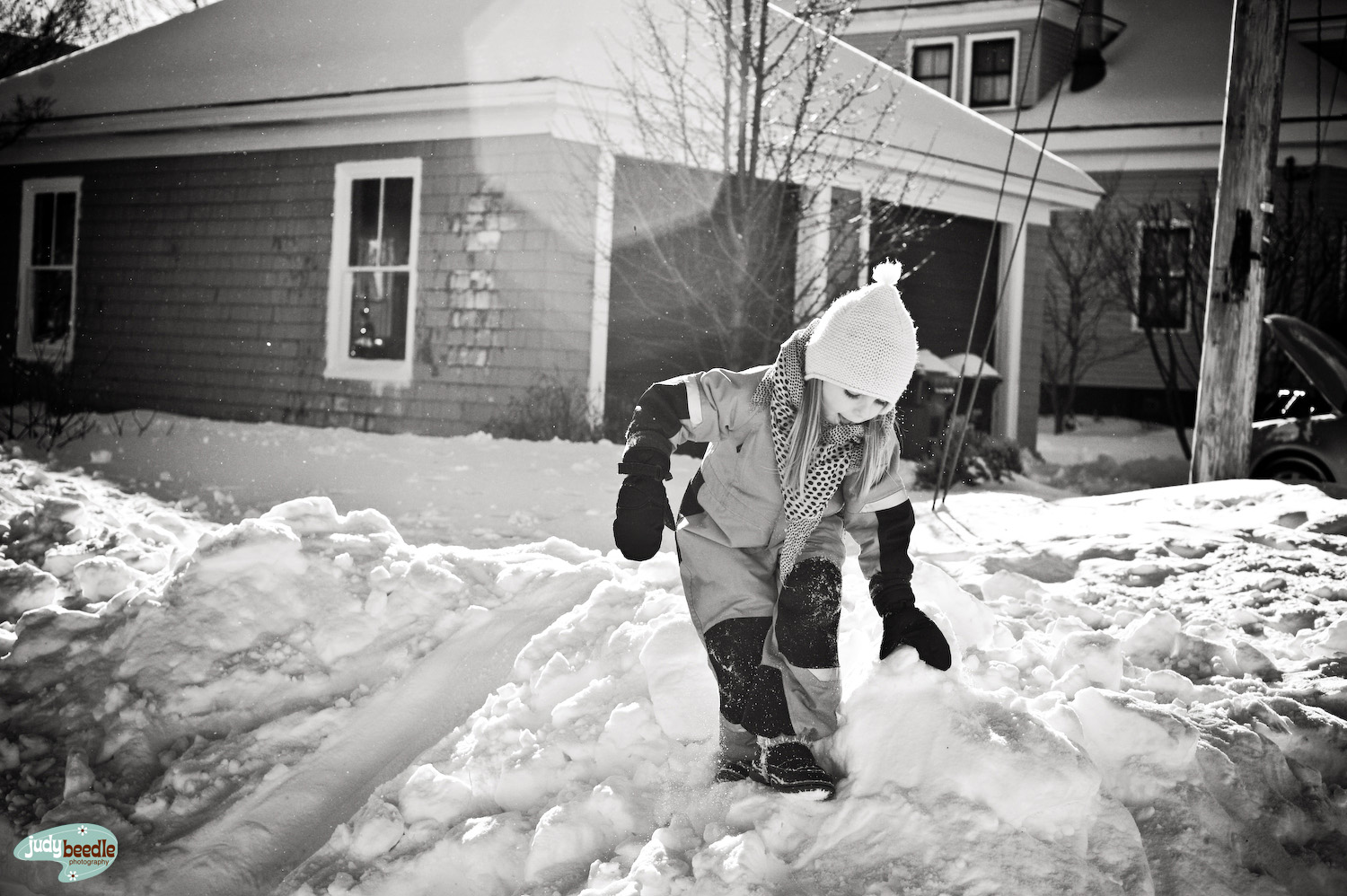 {30/365} Nella my neighbor playing in the snow while my car battery gets charged in the background. :D
