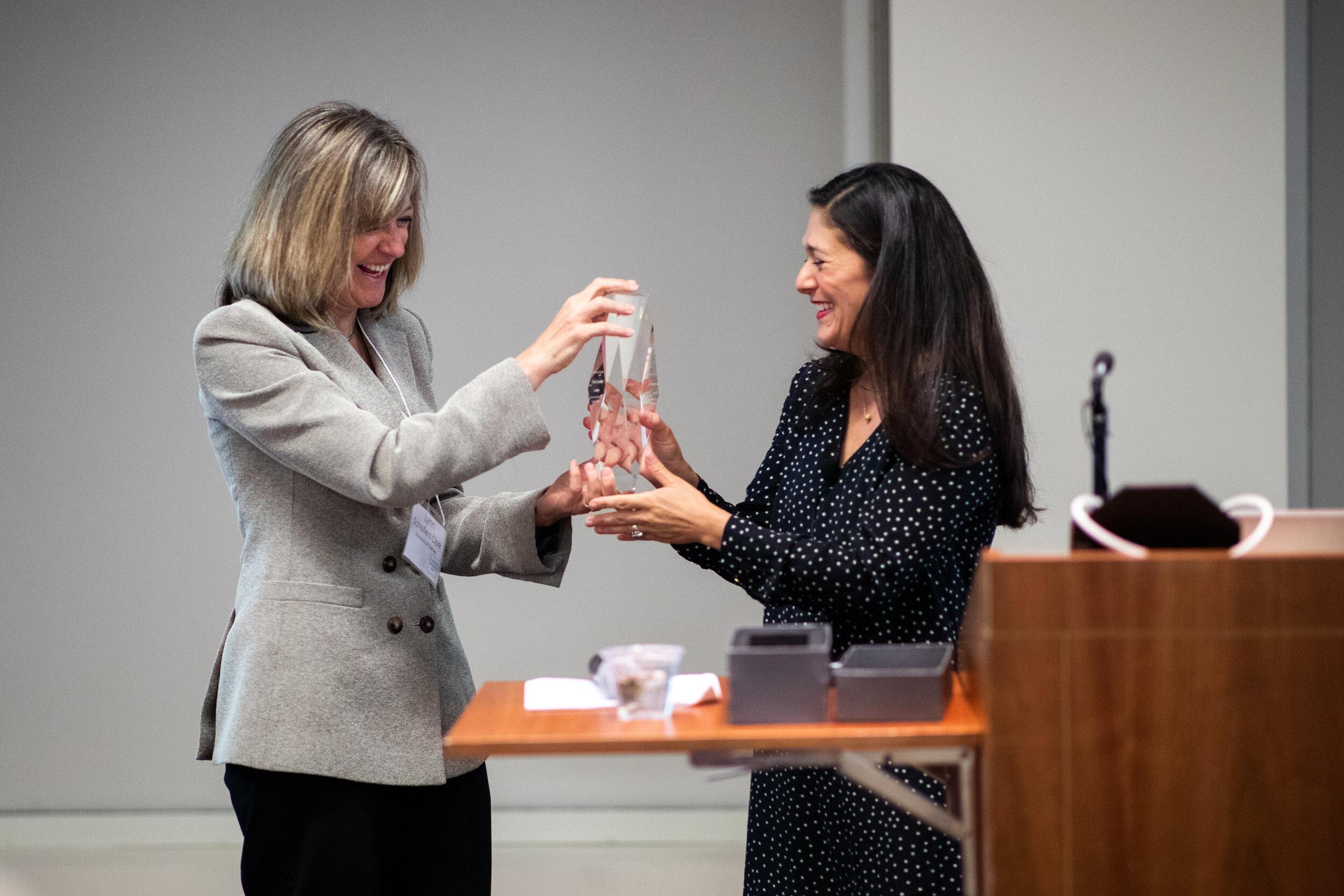 DU Media Professor  Lynn Schofield Clark  presents the Anvil of Freedom Award to LA Times immigration journalist  Cindy Carcamo .
