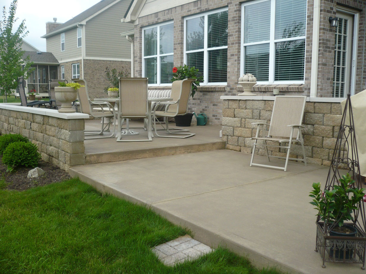 Patio Broom with Acid Stain Burnished copper (diluted) and Limestone Wall