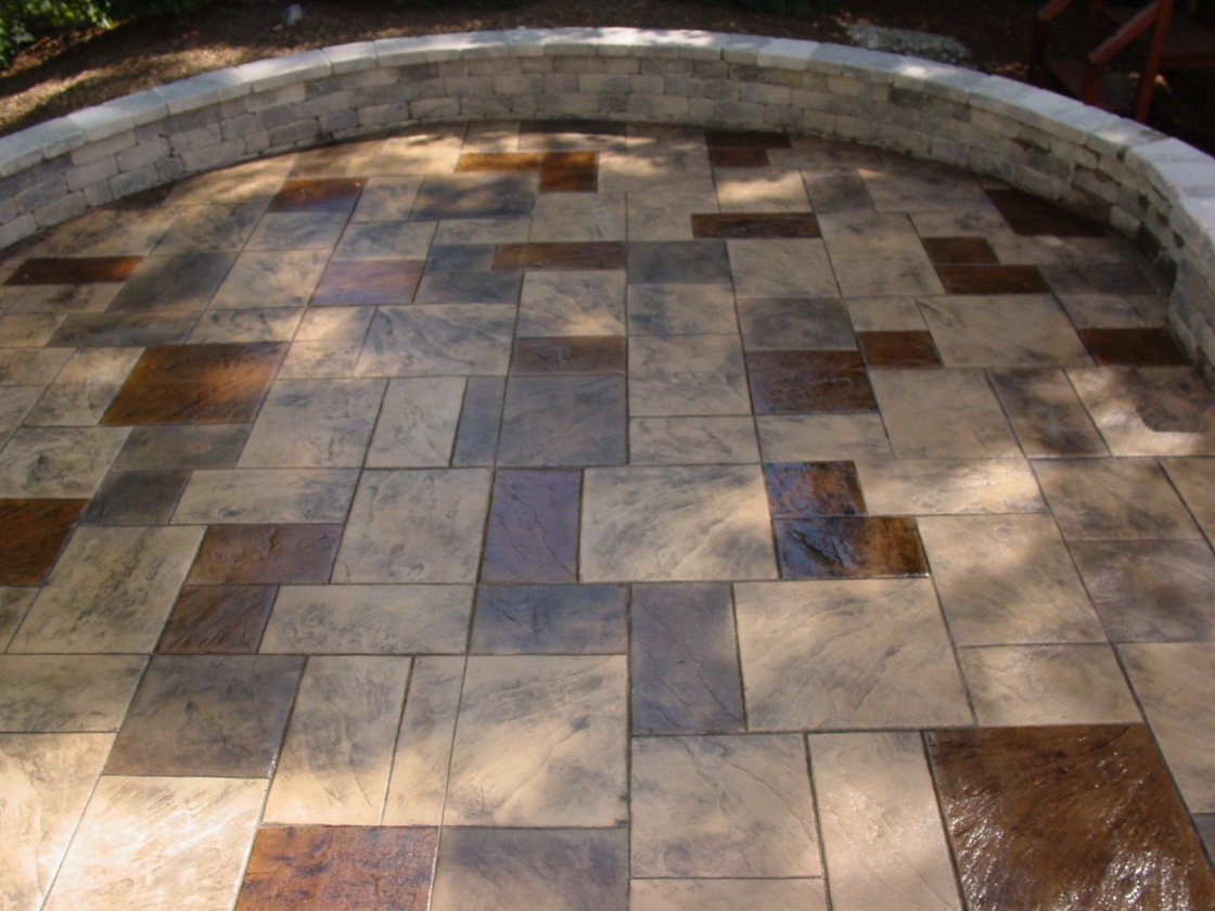 Large Ashlar Stamped Concrete with Oyster White base color and Autumn brown release with Acid Stain Porch