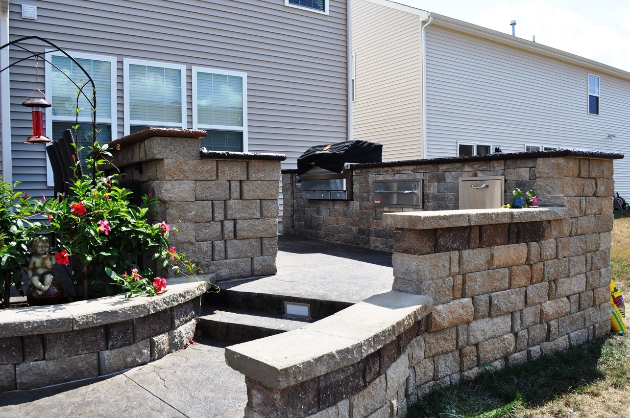 Outdoor Kitchen, textured Old granite, Mesa buff, charcoal gray, Limestone wall and base with accent block