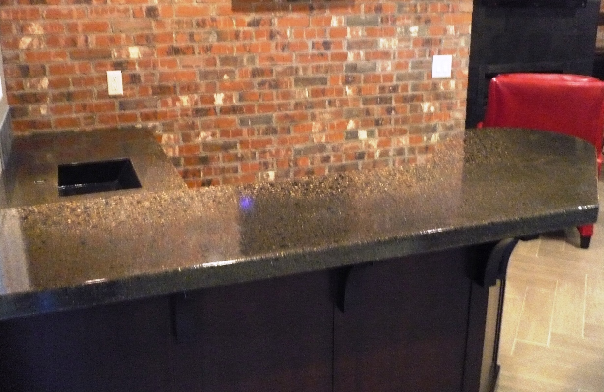 Precast Pour and Vibrate Countertop with Chang Charcoal color, Black and Clear Glass, and Fossil, Embeds, Epoxy Sealer 0