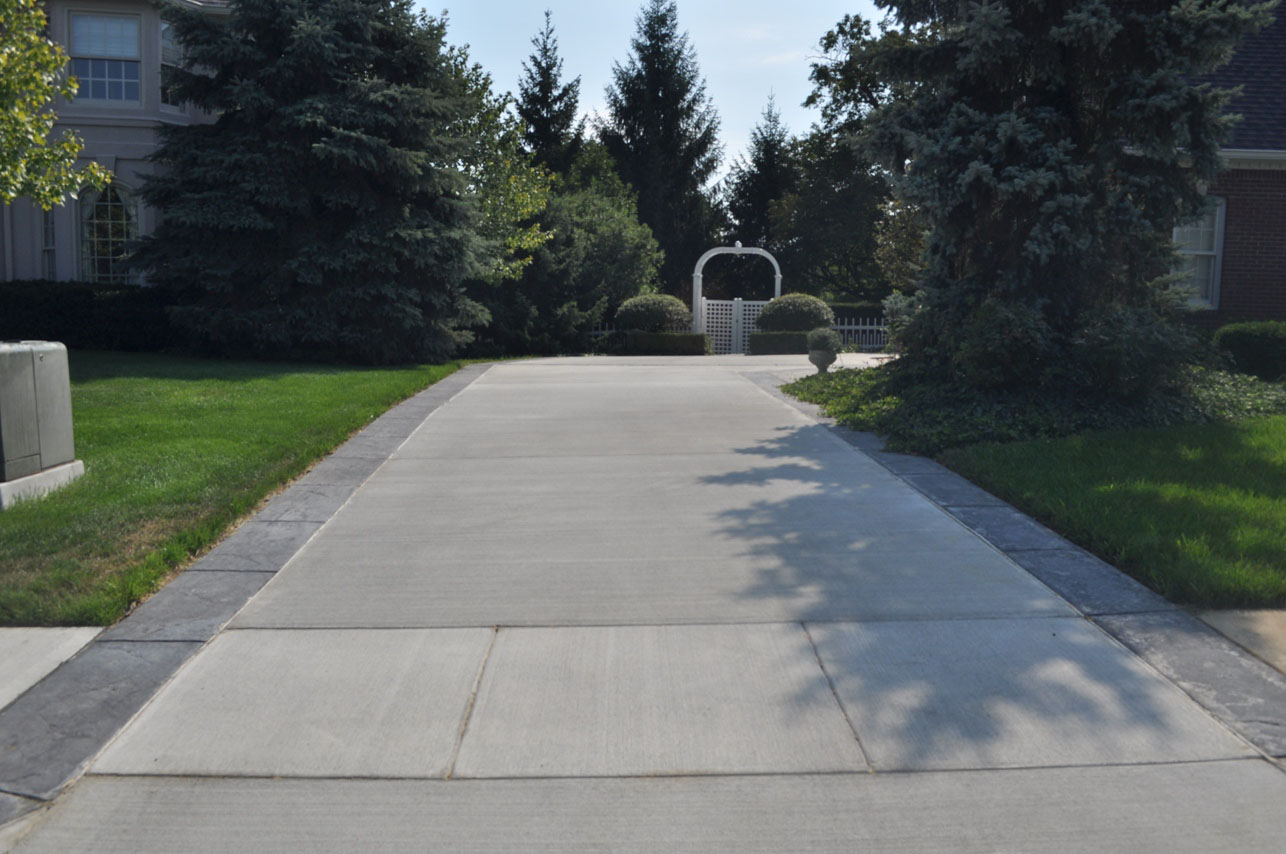 Broom Driveway with Old Granite Textrure Border with Dove Gray Color and charcoal Gray Release