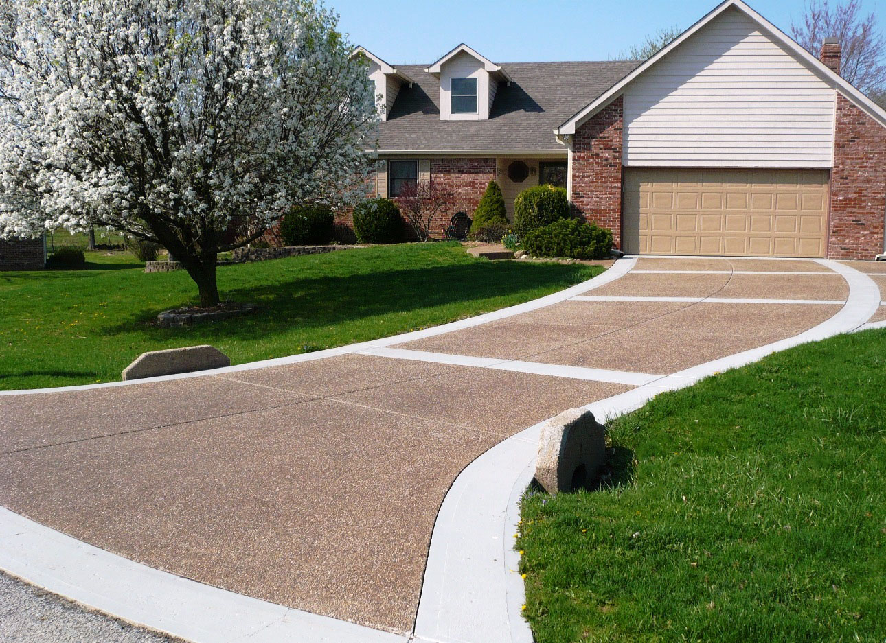 Exposed Pea Fill Aggregate Driveway with brown pigmented sealer and pigmented borders - sealed 2010 20 years old