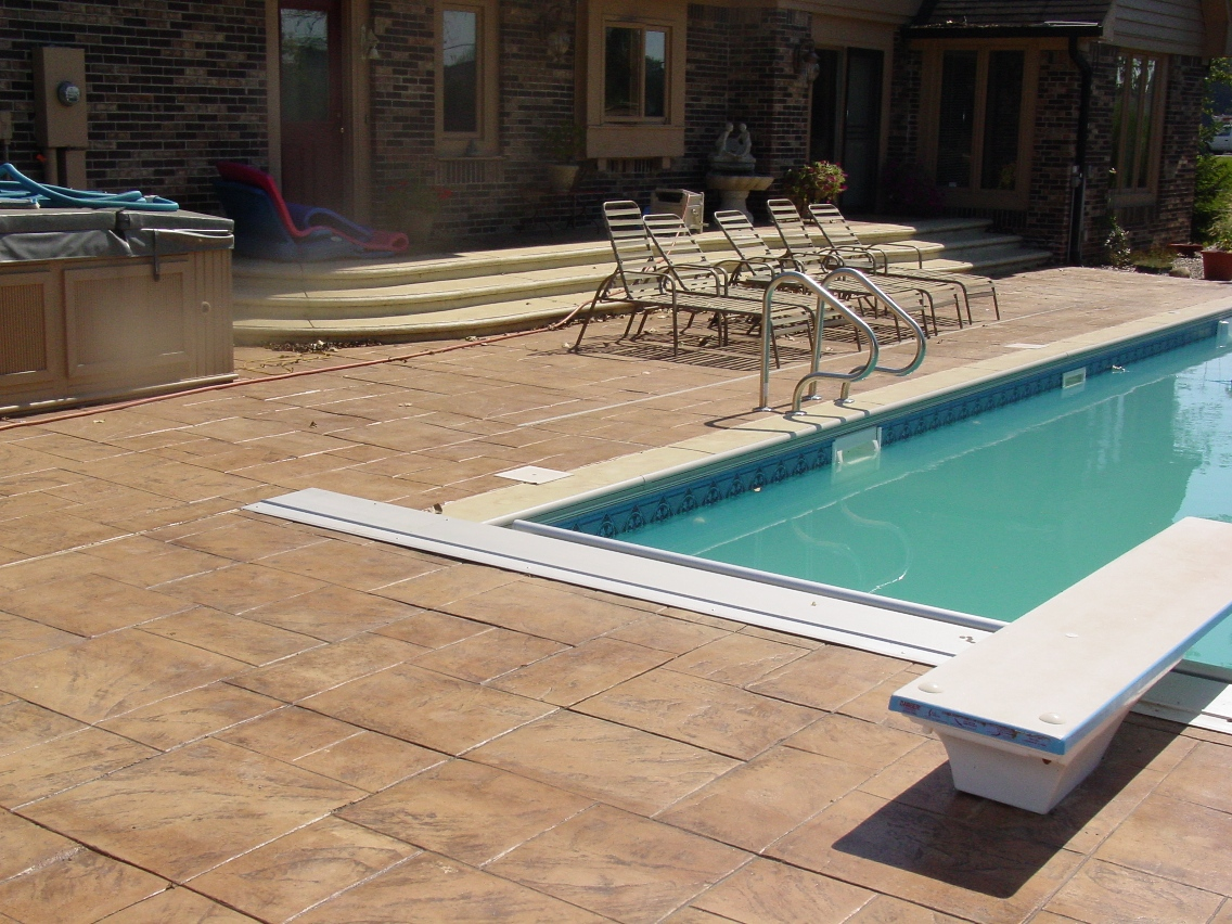 Large Ashlar Stamped Concrete with Oyster White Base and Autumn Brown Release Pool Deck
