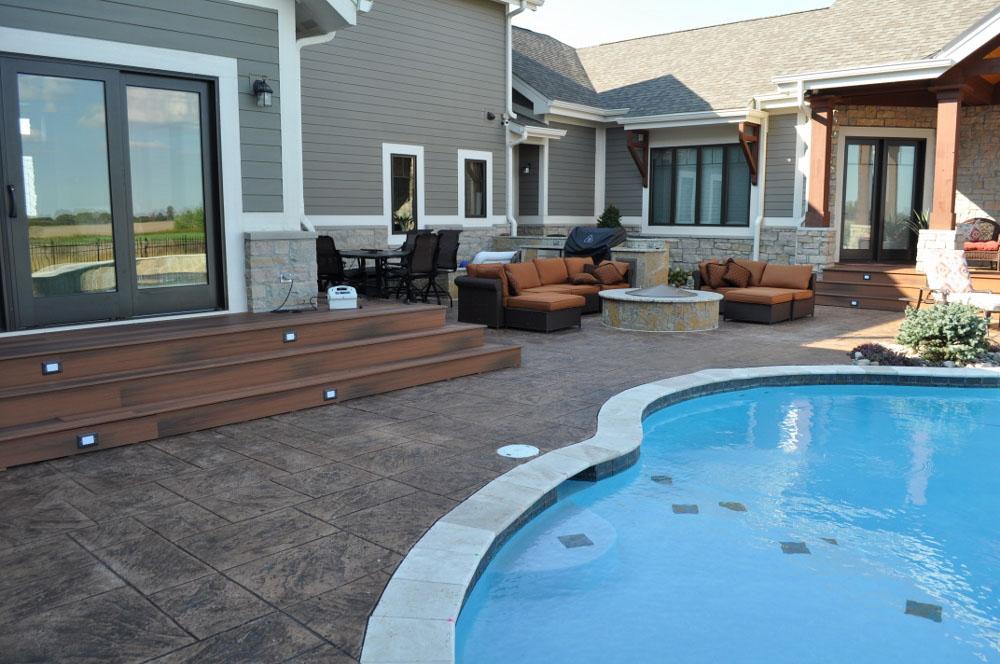 pool deck, large ashlar slate stamp, with rock salt add, sandstone base with dark walnut release 5