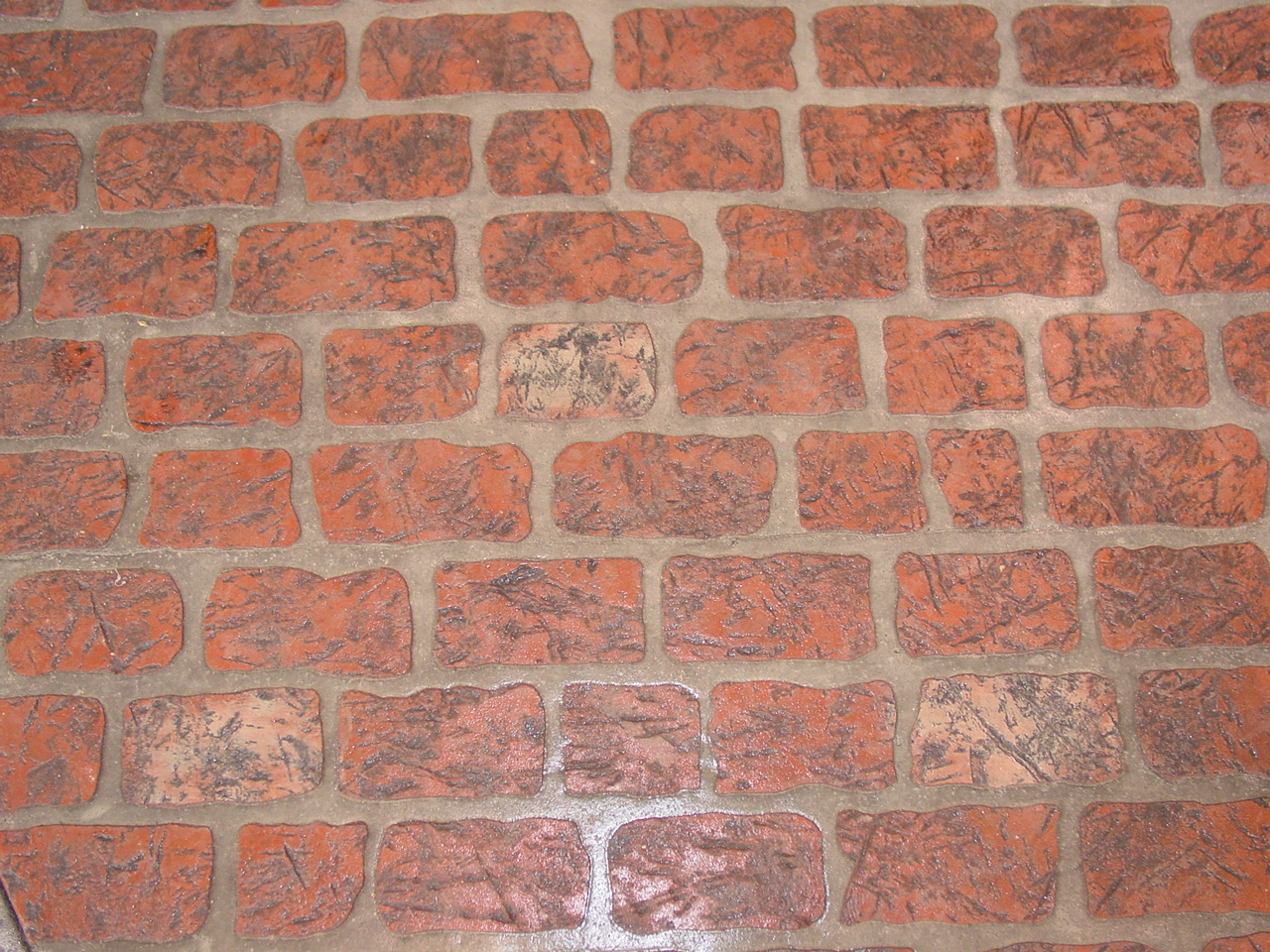 Old Chicago Brick Stenciled Concrete with Brick Red Color, Sunset Rose splash with Charcoal Gray Release