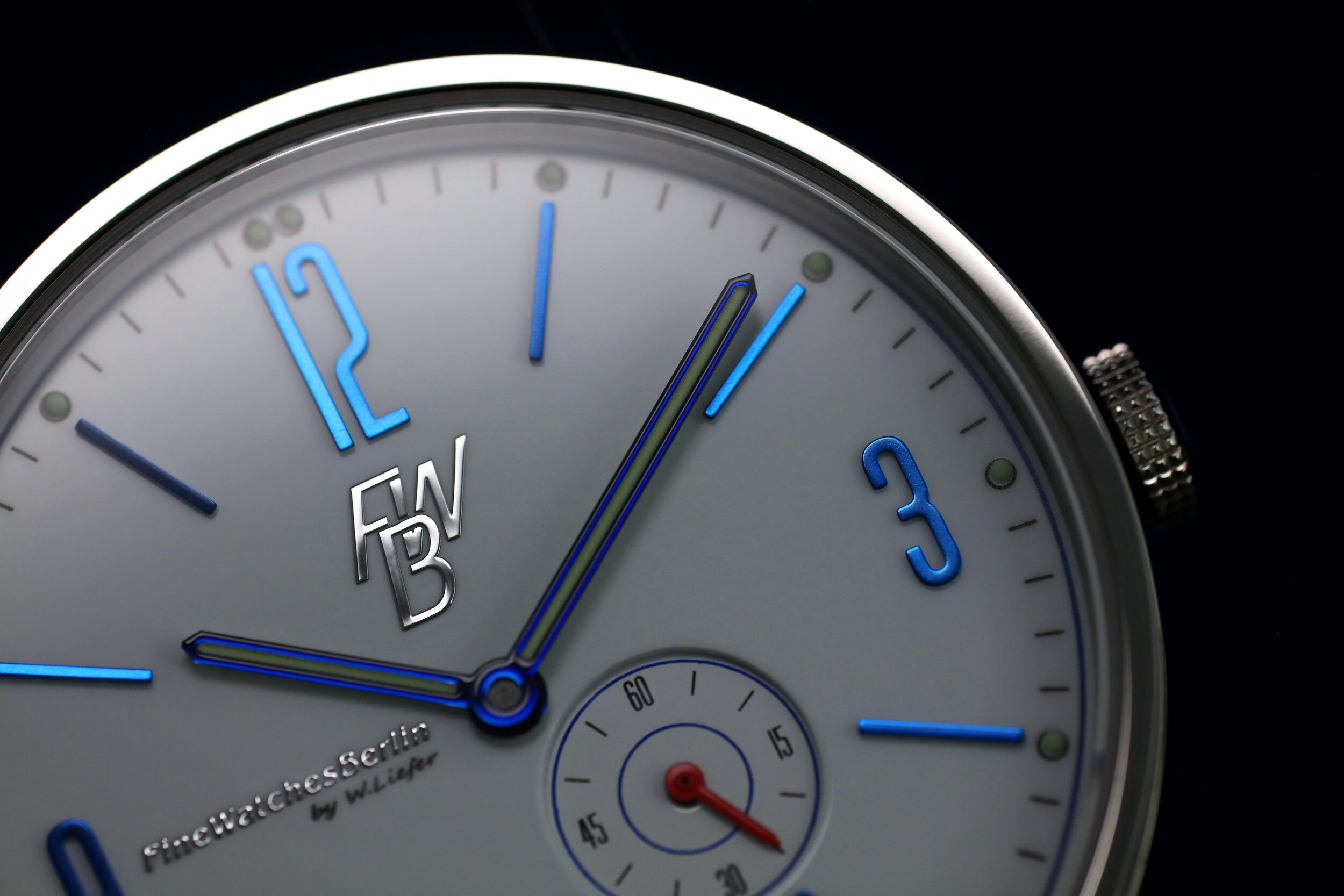 Shiny, blue details on a crisp, white dial never goes out of style!