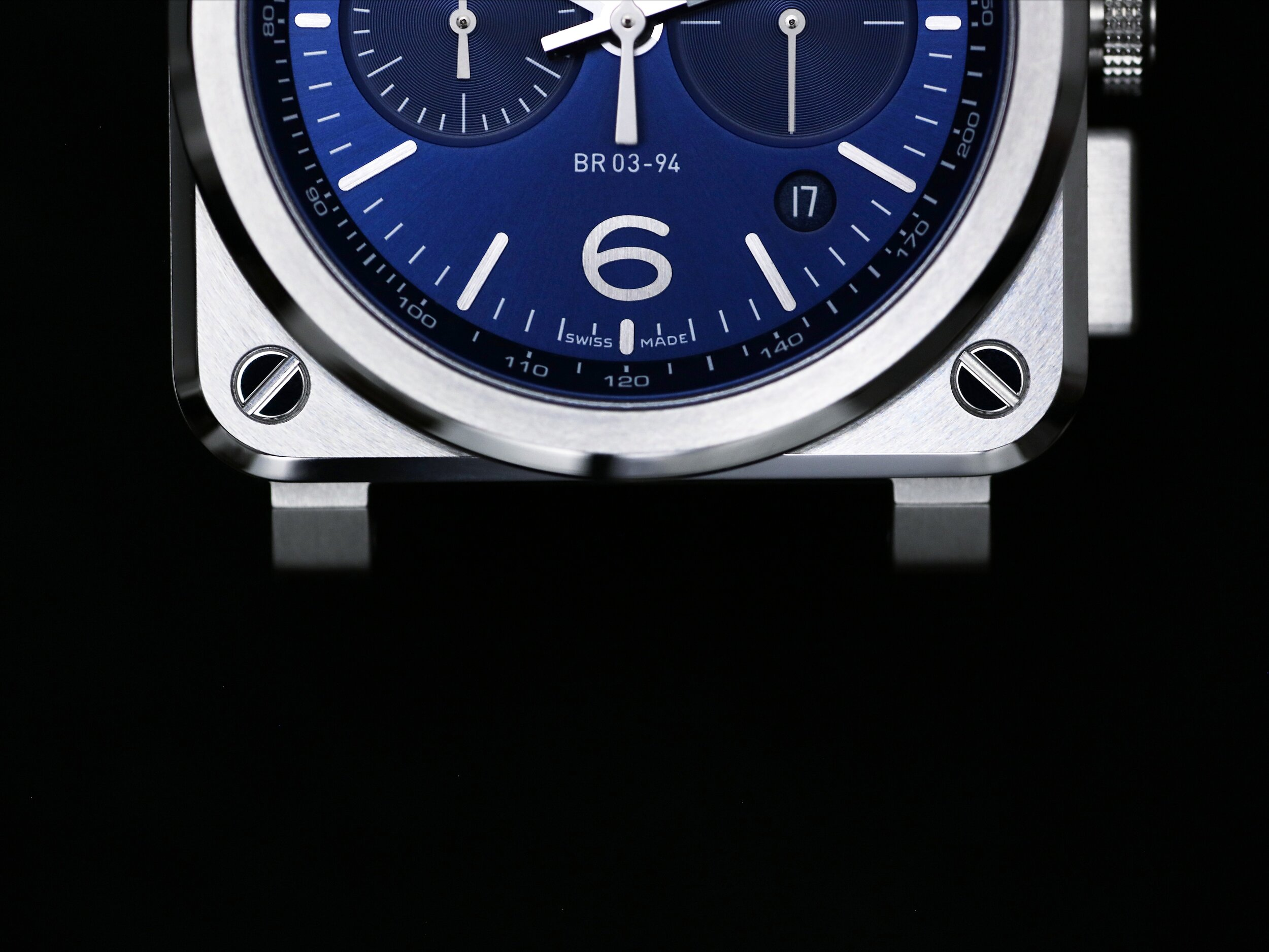A deep blue dial on a satin-polished square-shaped case.