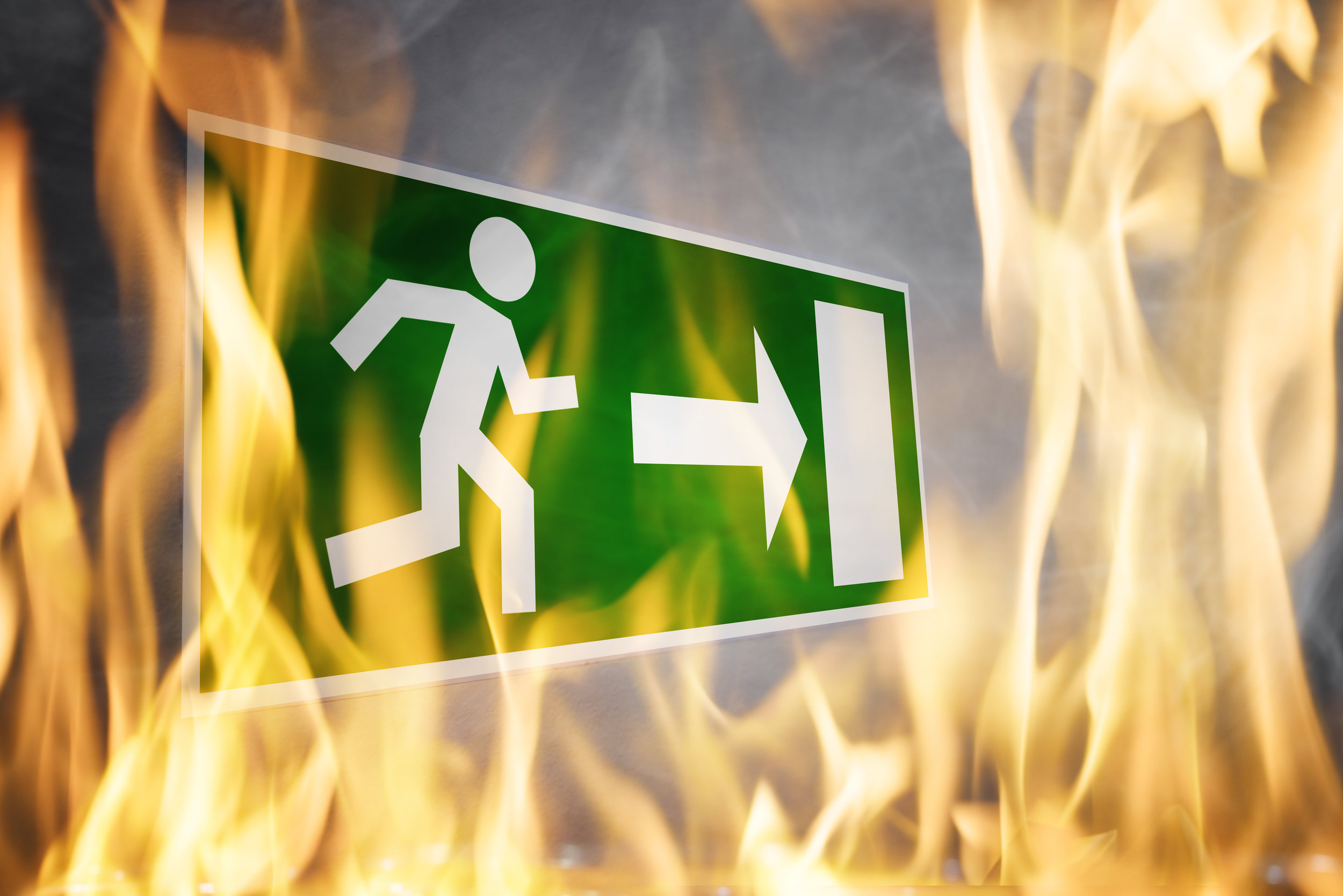 Close-up Of Emergency Fire Exit Board