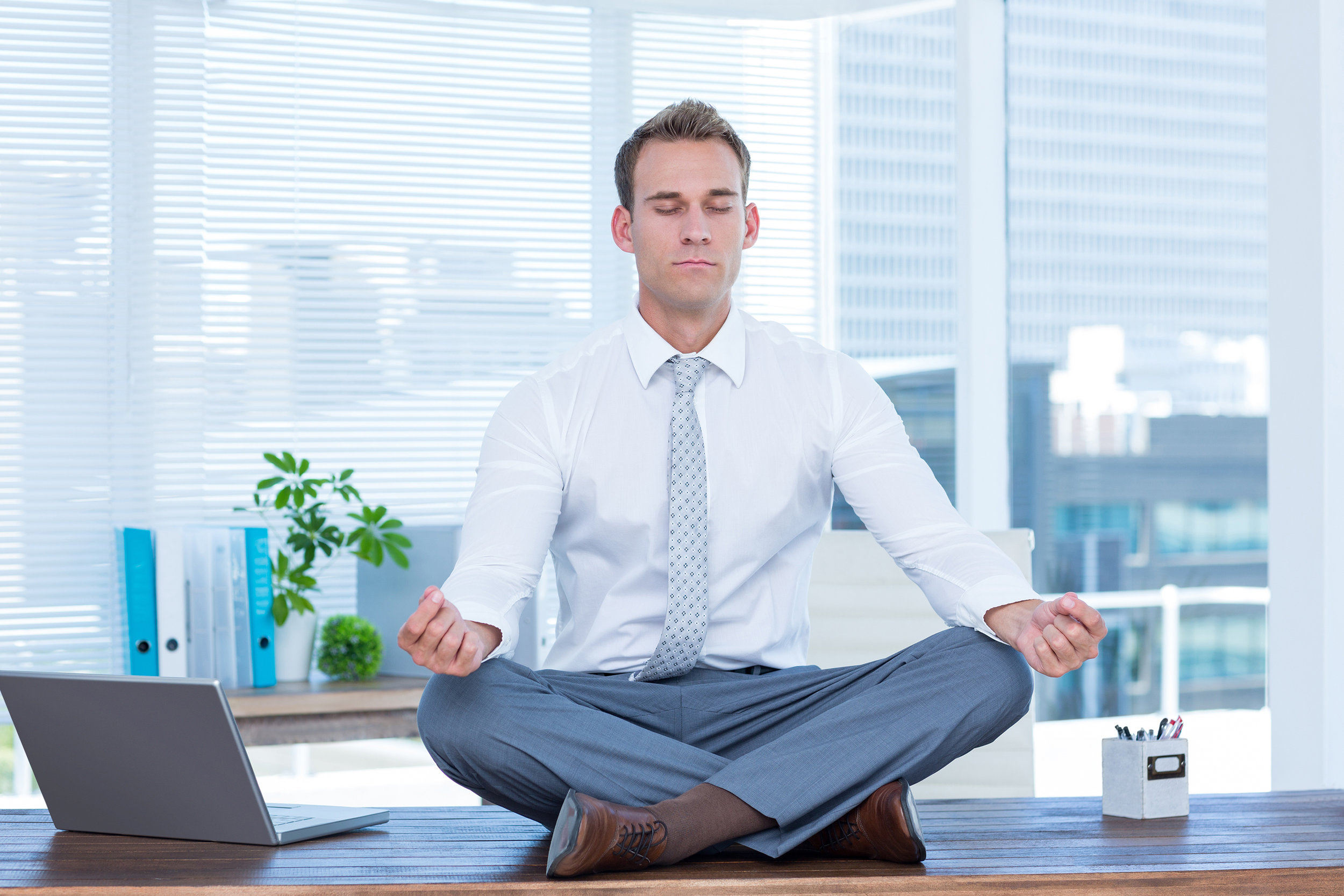 Zen businessman doing yoga meditation