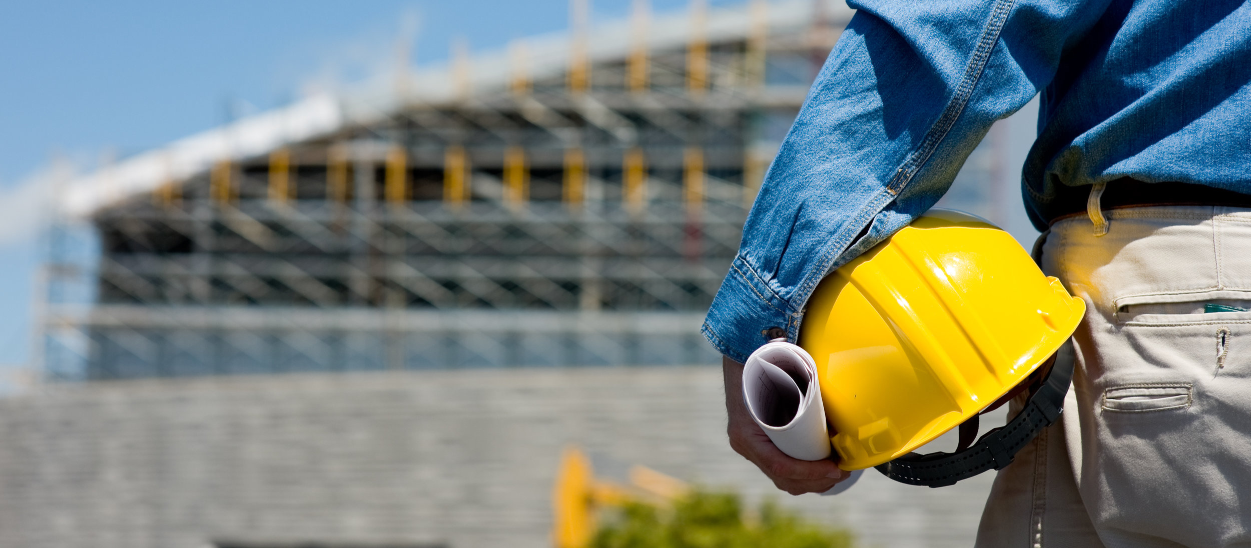 A construction worker or foreman at a construction site