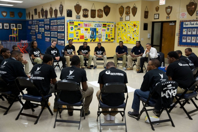 President Obama sits in on a BAM circle during a 2013 visit to Hyde Park Career Academy in Chicago. Photo: Pete Souza, White House