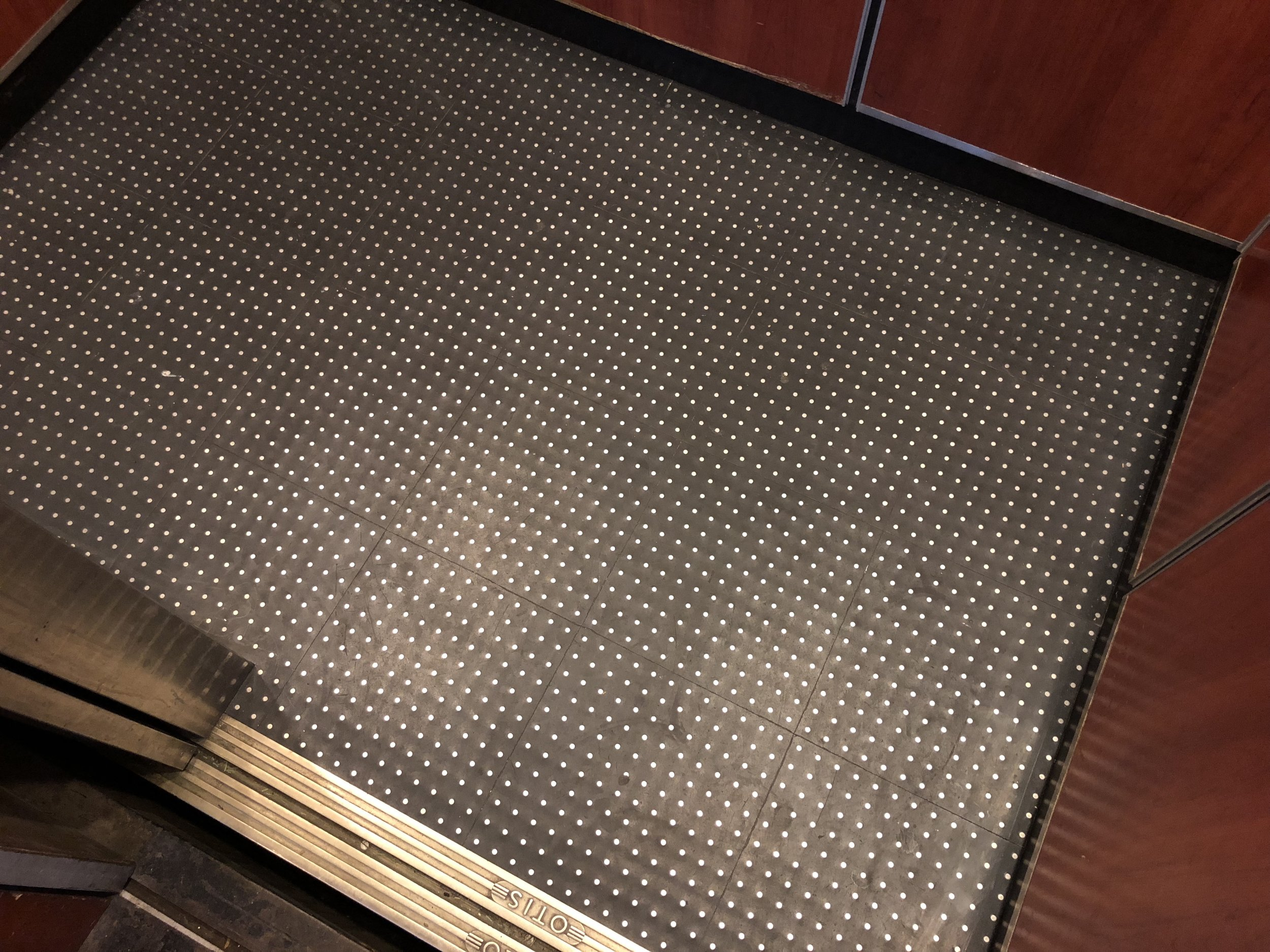 STUDDED TILE - A popular choice for service elevator cabs, commercial use buildings and single car buildings, rubber studded tiles is one of the most long lasting choices for elevator cab flooring. The black rubber floor comes with studs that are either Stainless Steel or Bronze (depending on the metal finishes in your cab) and are able to withstand all different types of everyday use.SUGGESTED USE:LOW TO HIGH TRAFFIC COMMERCIALLOW TO HIGH TRAFFIC RESIDENTIALSERVICE CABPASSENGER CAB