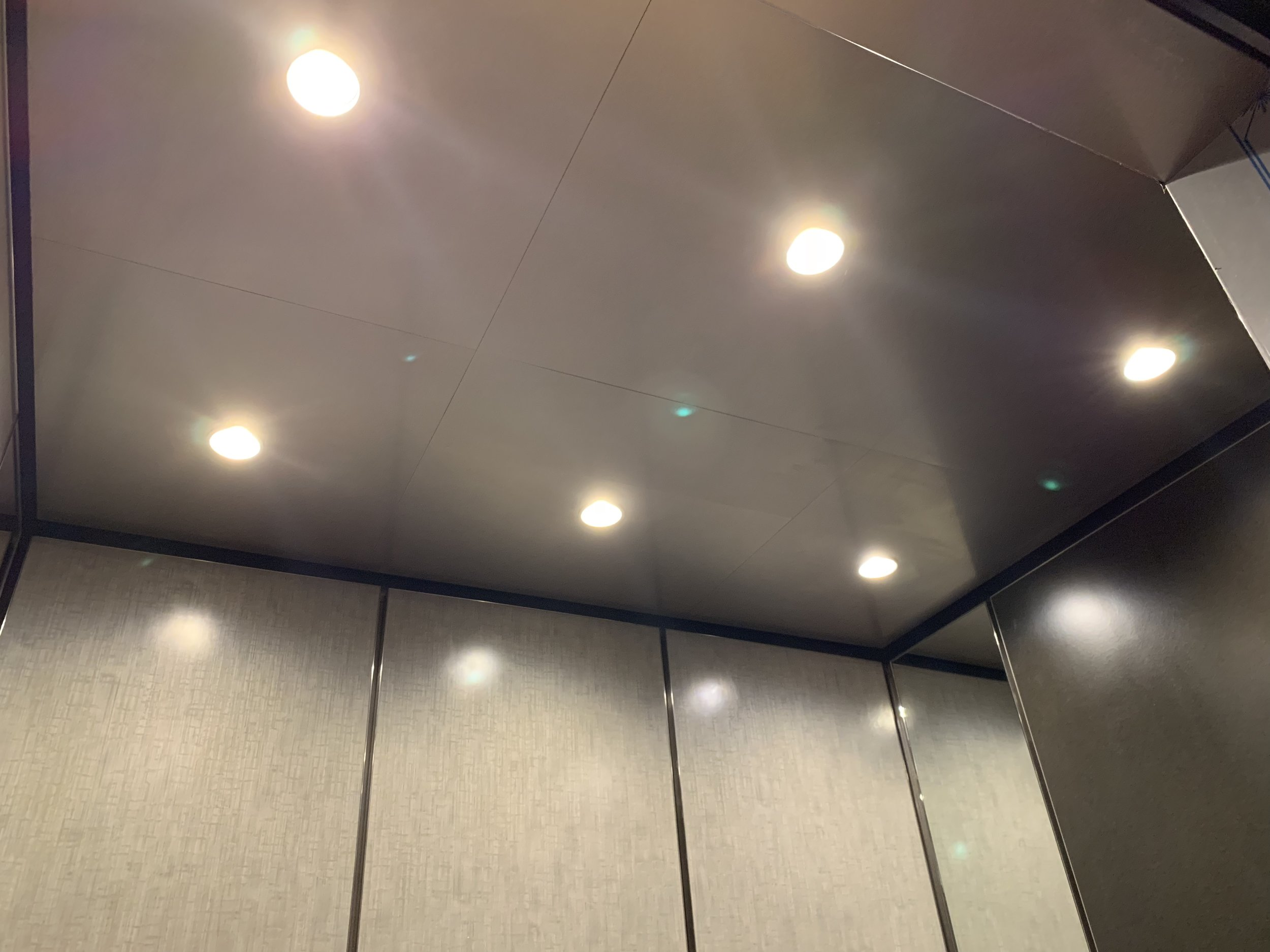 THE JACOB - The Jacob ceiling is a standard suspended ceiling manufactured out of metal with an island design. It features a typical tile design with LED down-light fixtures pre-installed and is on a fire-rated substrate. The Jacob ceiling is easy to install, light-weight and features emergency lighting as a part of the down-light fixture system.