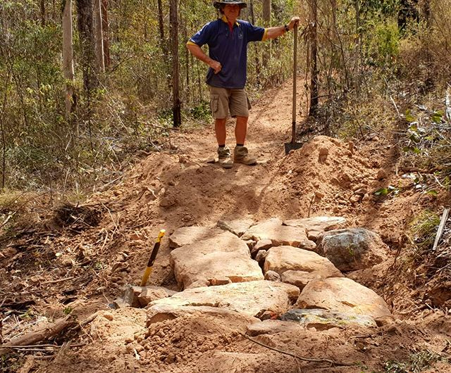 Rock armoring where water will flow across the trail is key to longevity. Spend the extra time to get a trail that will last many summer storm seasons.  #trailbuilding #tamrookumenduro #tamrookumendurofest