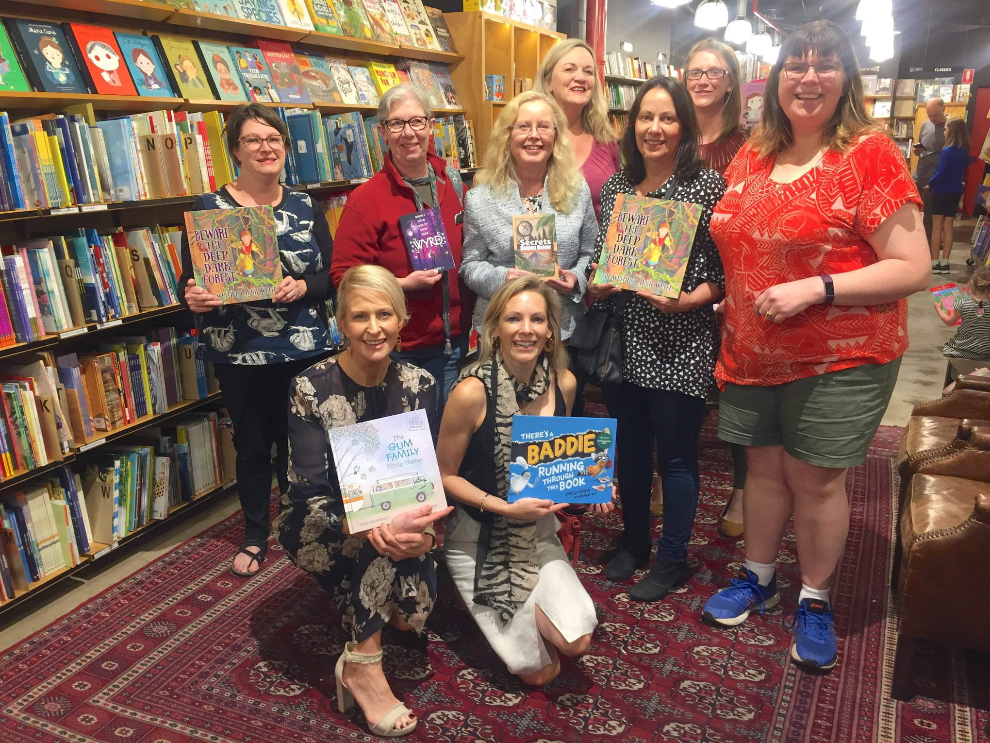 A bunch of amazing authors celebrating the launch of Sue Whiting's latest PB, all holding their own recent releases.