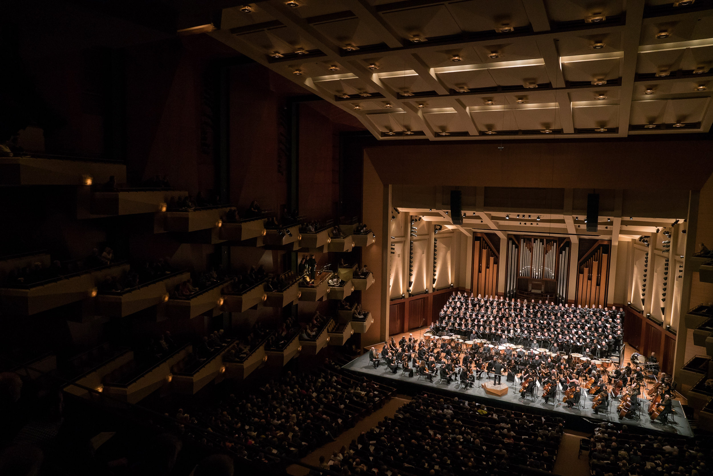 """Ludovic Morlot leads the Seattle Symphony in a performance of Berlioz's Requiem at Benaroya Hall in November 2017. Brass choirs were positioned aloft at each corner of the hall to generate the directional """"surround-sound"""" that Berlioz intended. Photo by Brandon Patoc."""