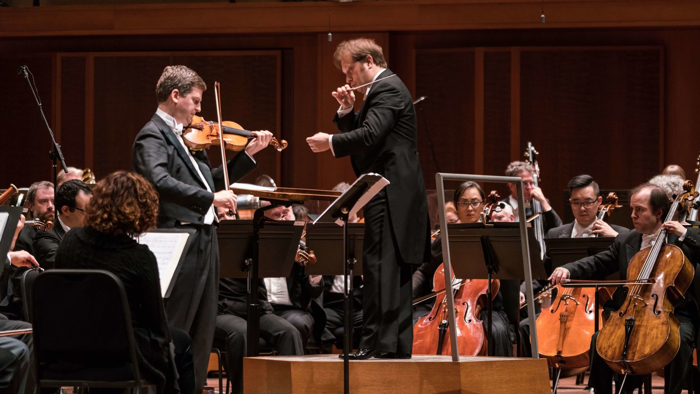 Violinist James Ehnes and Seattle Symphony Music Director Ludovic Morlot during the live performance of Aaron Jay Kernis' Violin Concerto in March 2017. Photo by James Holt.