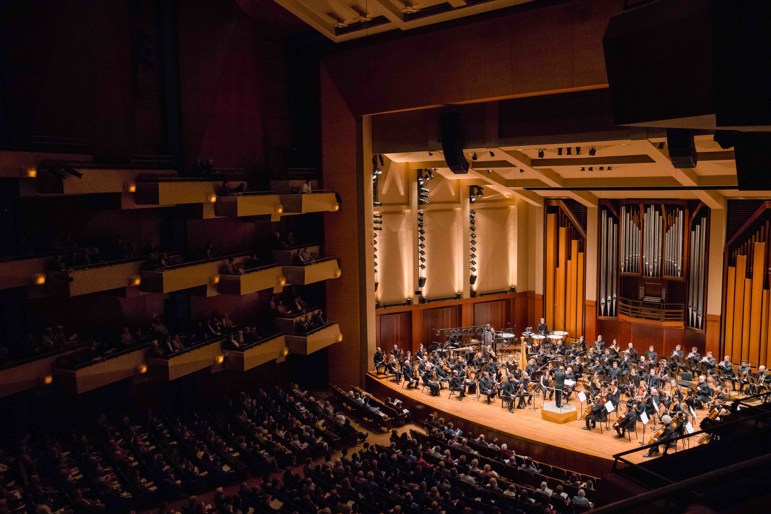 Ludovic Morlot conducts the Seattle Symphony through the timbrally-rich work of 'La Source d'un regard' by contemporary French composer, Marc-André Dalbavie in an April 2019 performance in Benaroya Hall. Photo by Brandon Patoc.